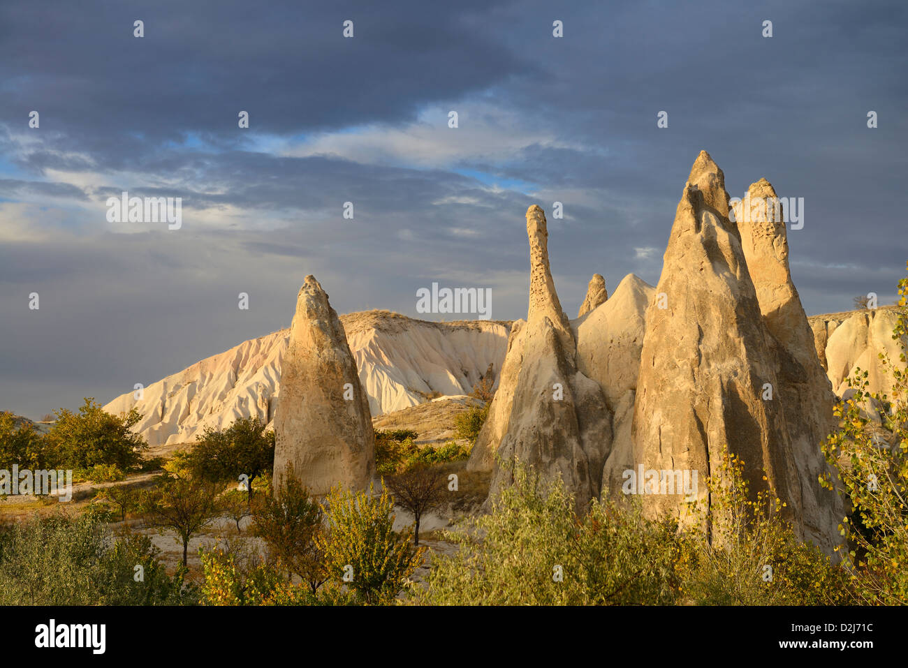 Evening sun on eroded rock spires of the Red Valley Cappadocia Nevsehir Turkey - Stock Image