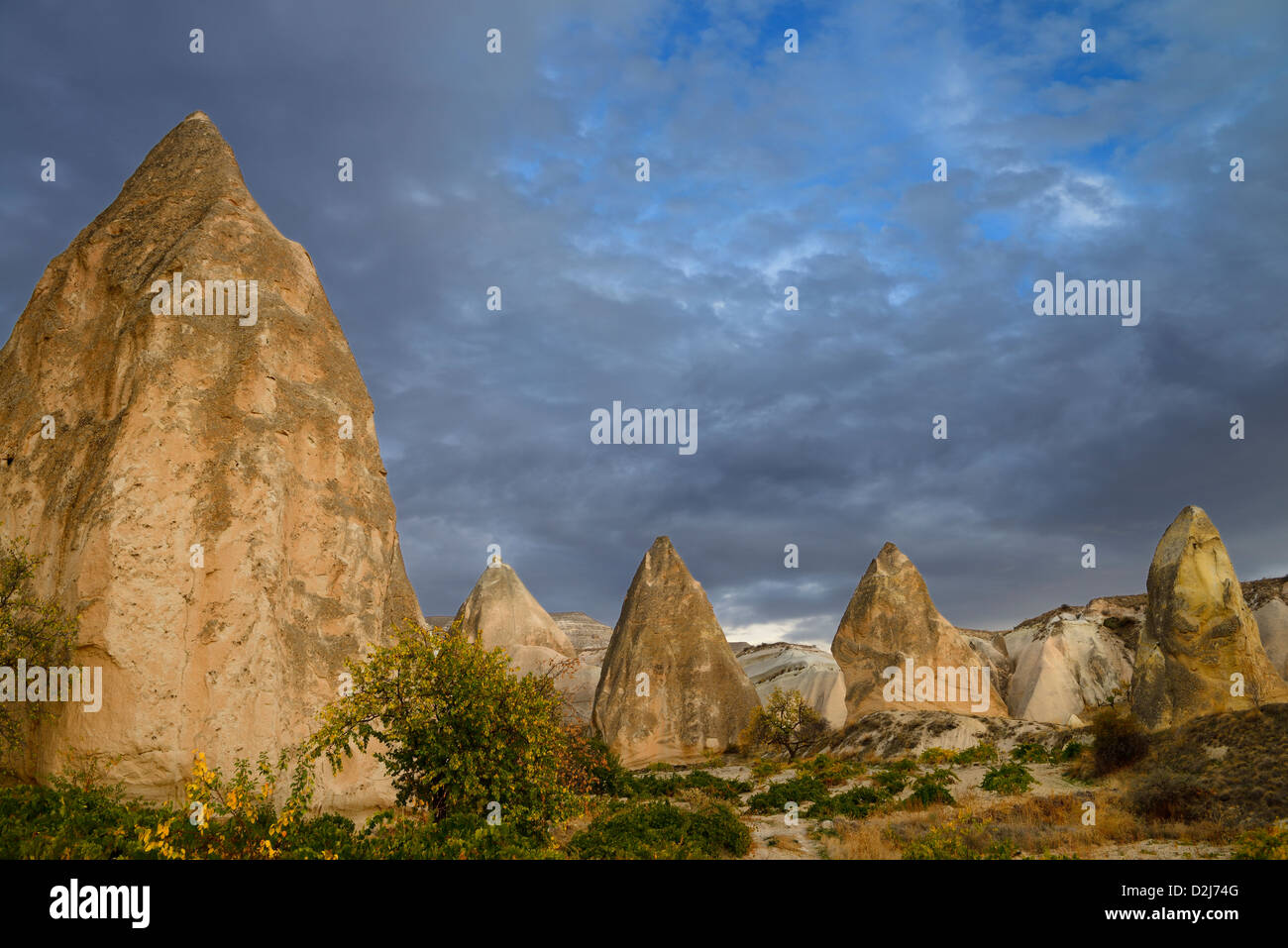Evening light on pointed Rock spires of the Red Valley Cappadocia Nevsehir Turkey - Stock Image
