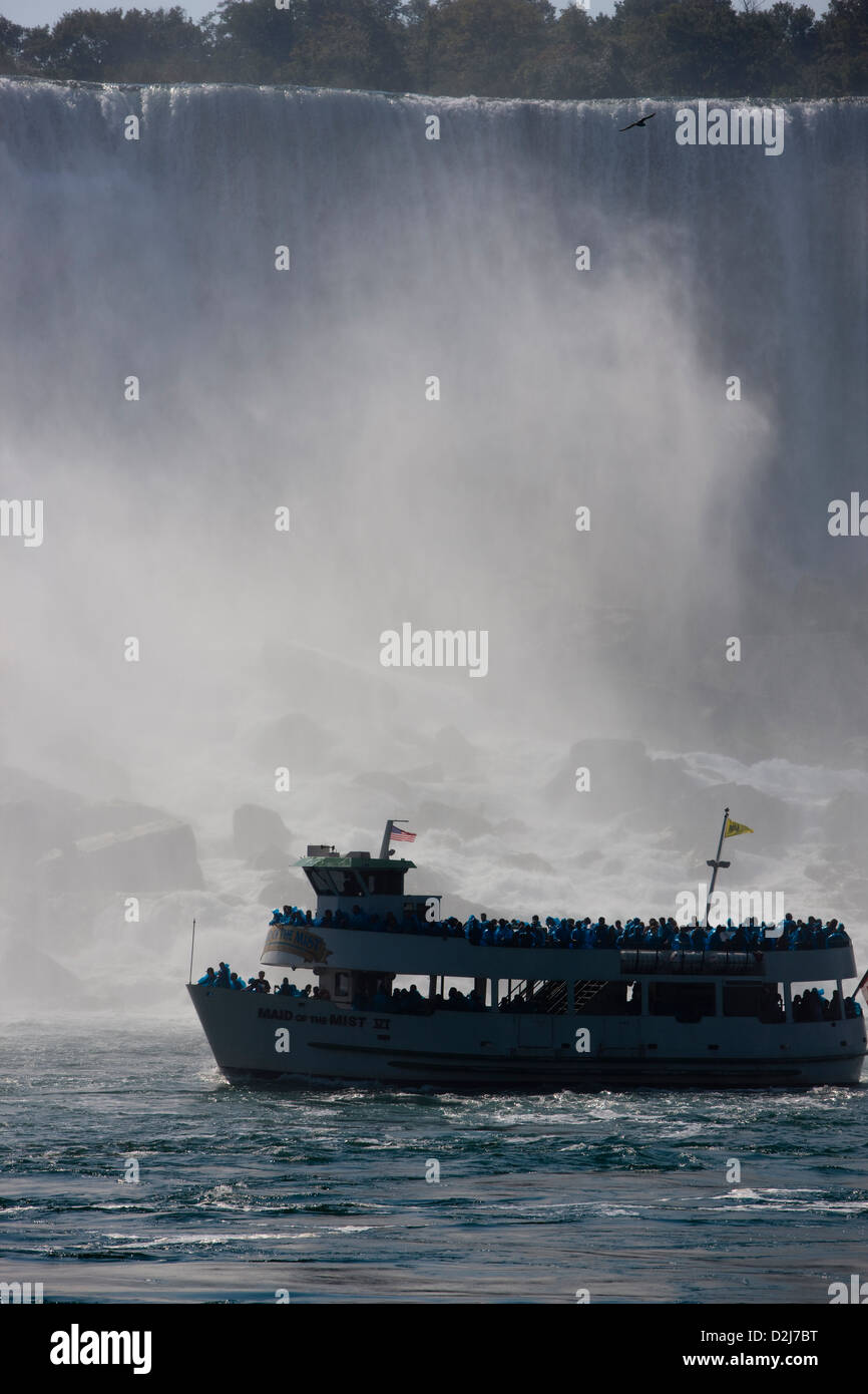 The Maid of the Mist tourist boat trip sailing past Niagara Falls, Canada - Stock Image