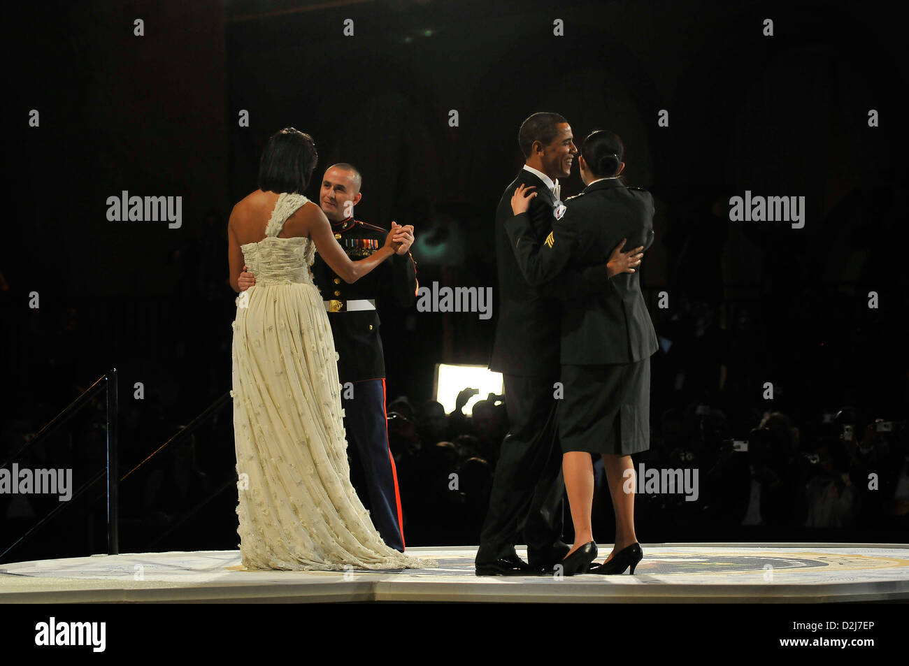 First lady Michelle Obama dances with US Marine Sergeant Elidio Guillen while President Barack Obama dances with - Stock Image