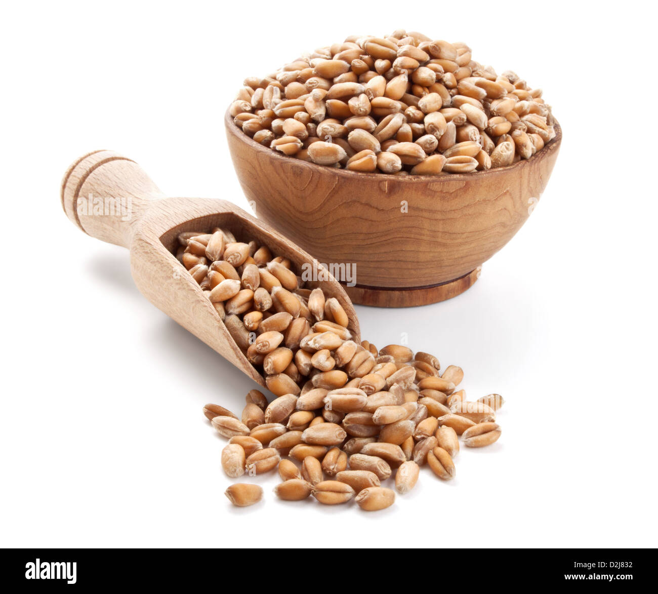 wheat grain in a wooden bowl isolated on white background - Stock Image
