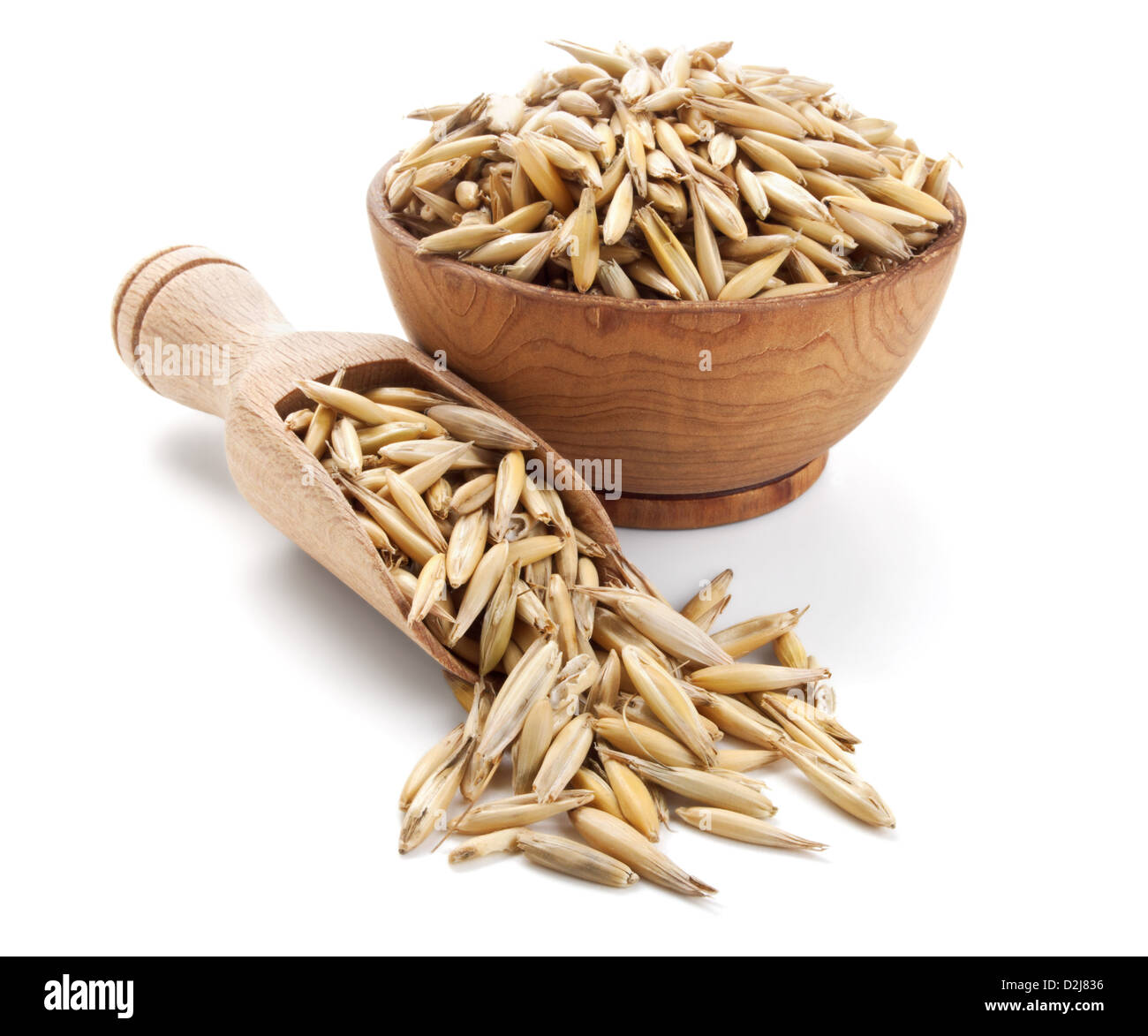 oat in a wooden bowl isolated on white background - Stock Image
