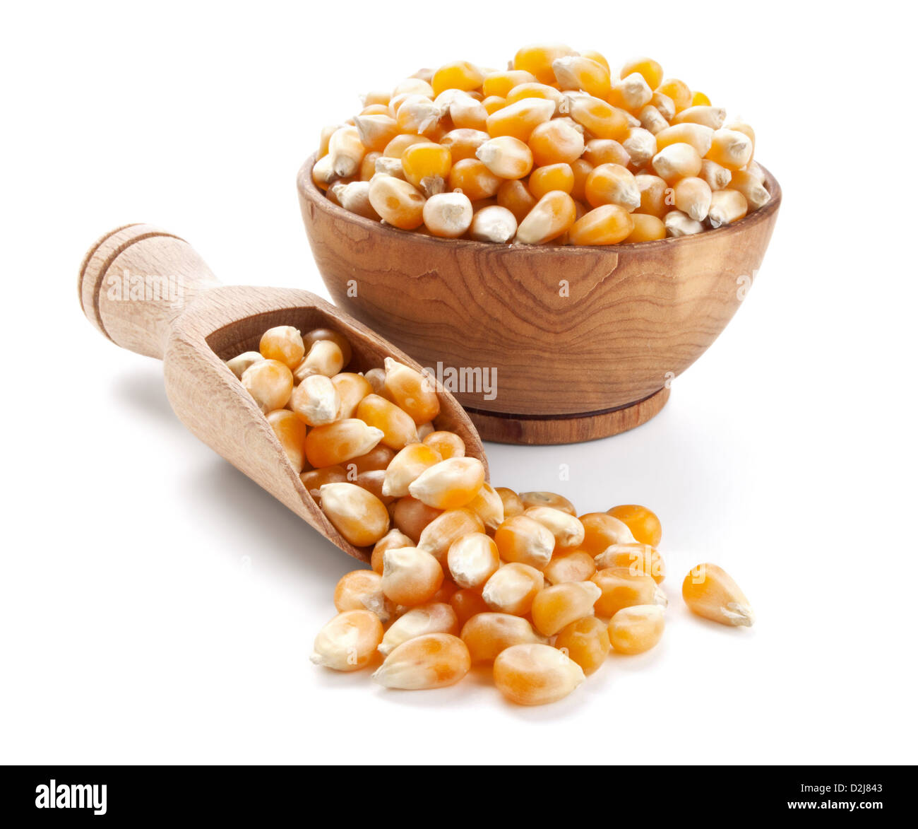 corn grain in a wooden bowl isolated on white background - Stock Image