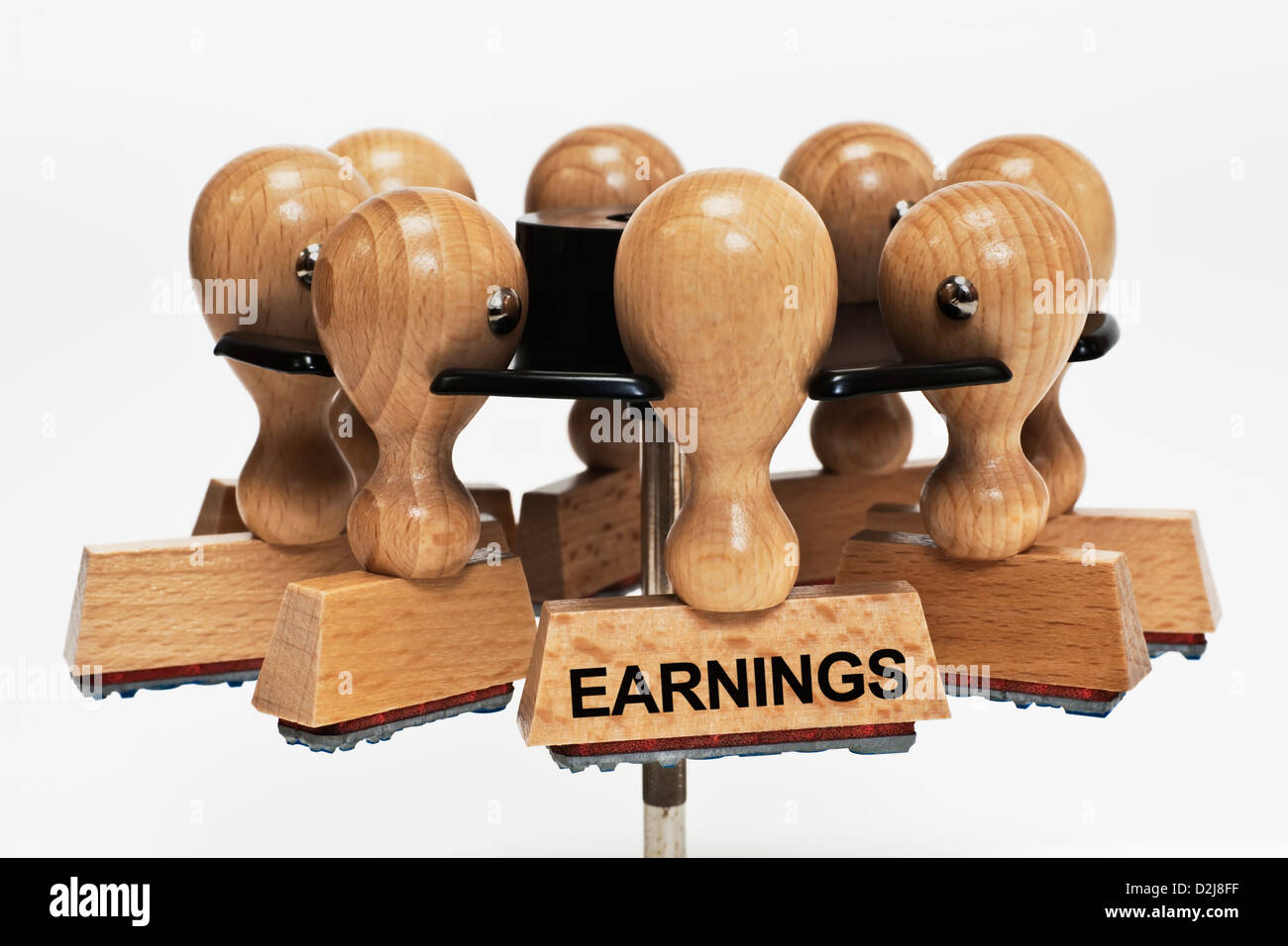 Many stamps hanging in a stamp rack. One stamp with the inscription earnings hangs in front, background white. - Stock Image