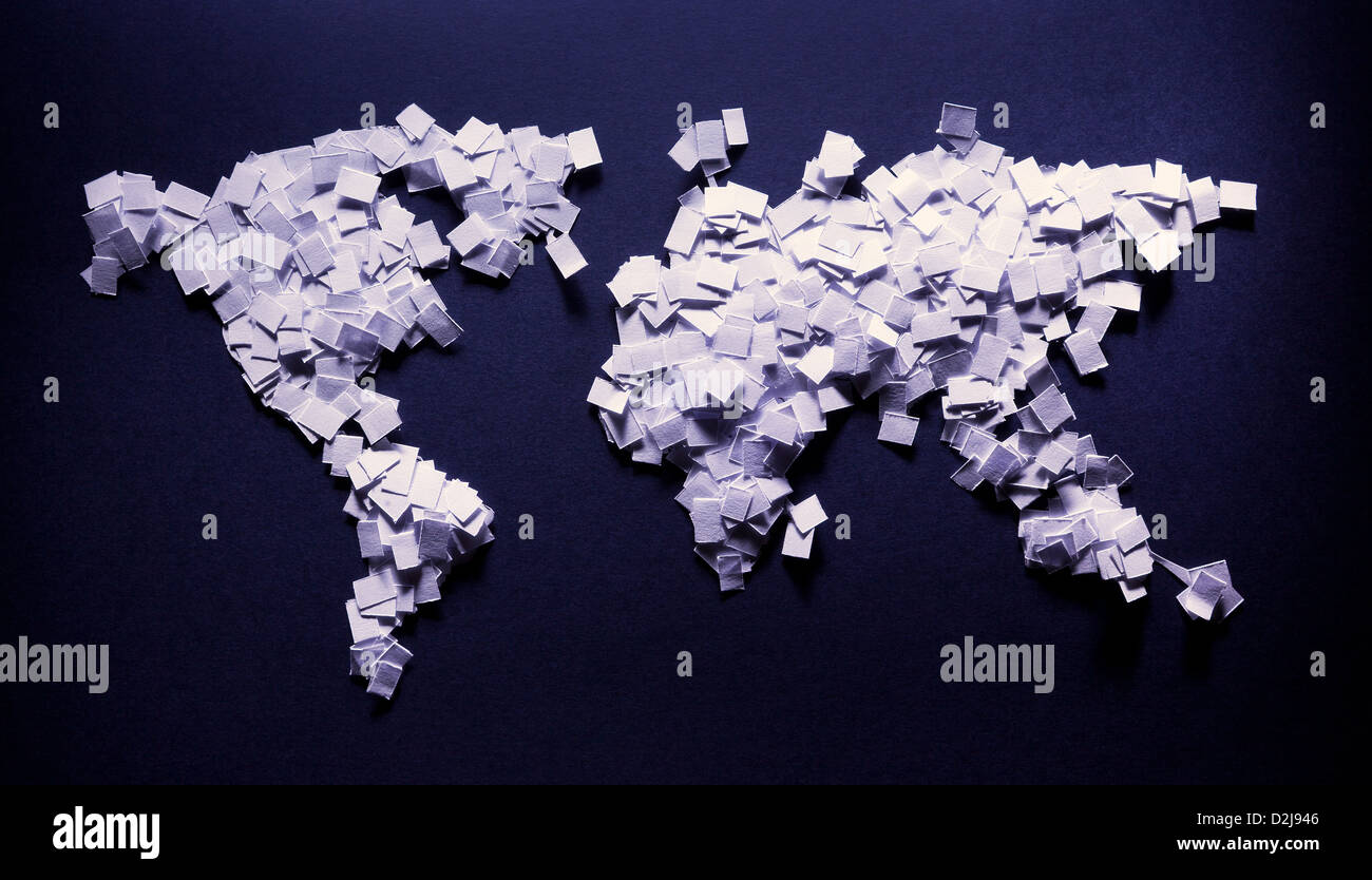 Earth map made of papers, some kind of mosaic, illuminated on blue background. - Stock Image
