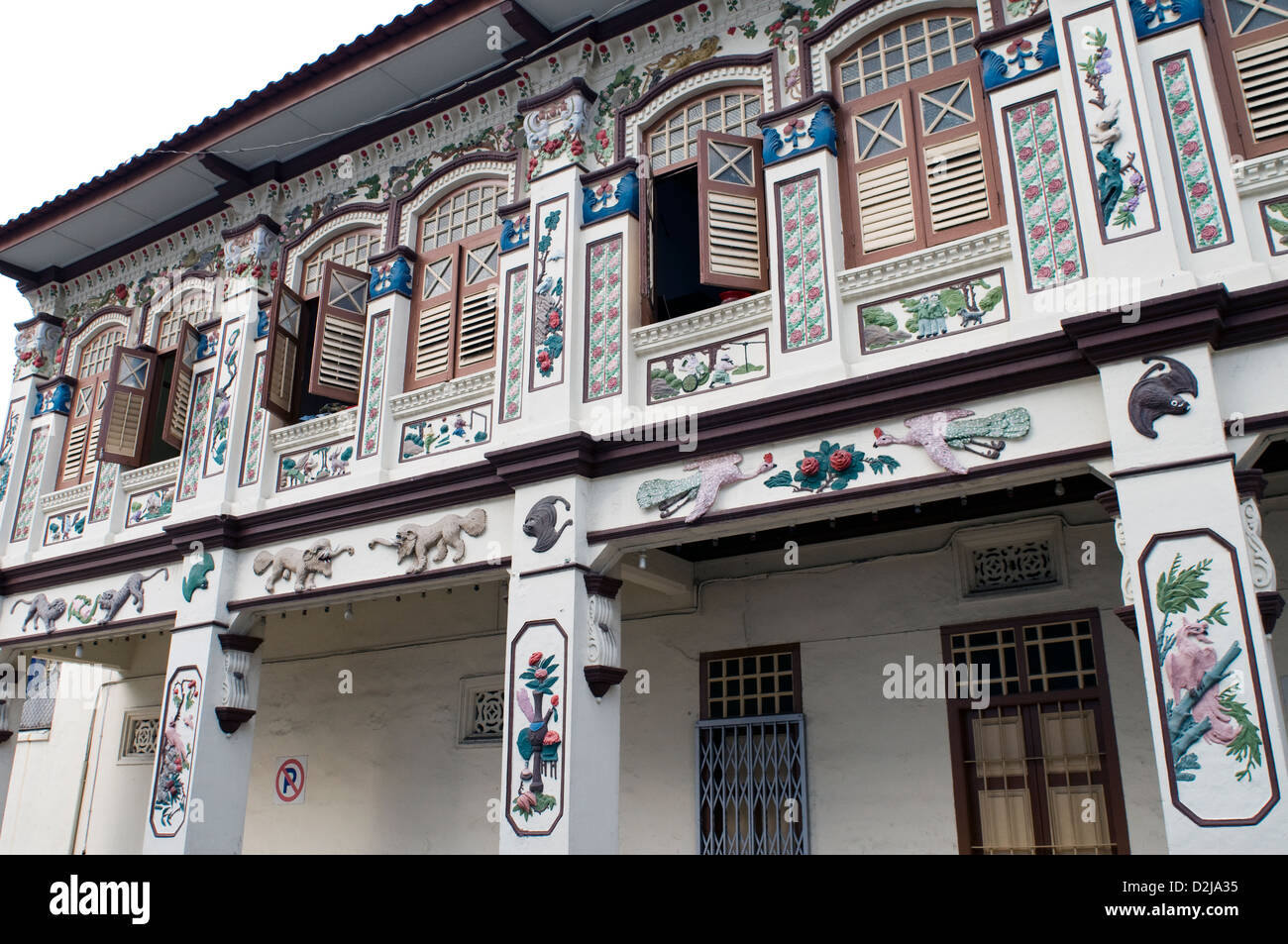 gaily painted shophouse, geylang, singapore - Stock Image
