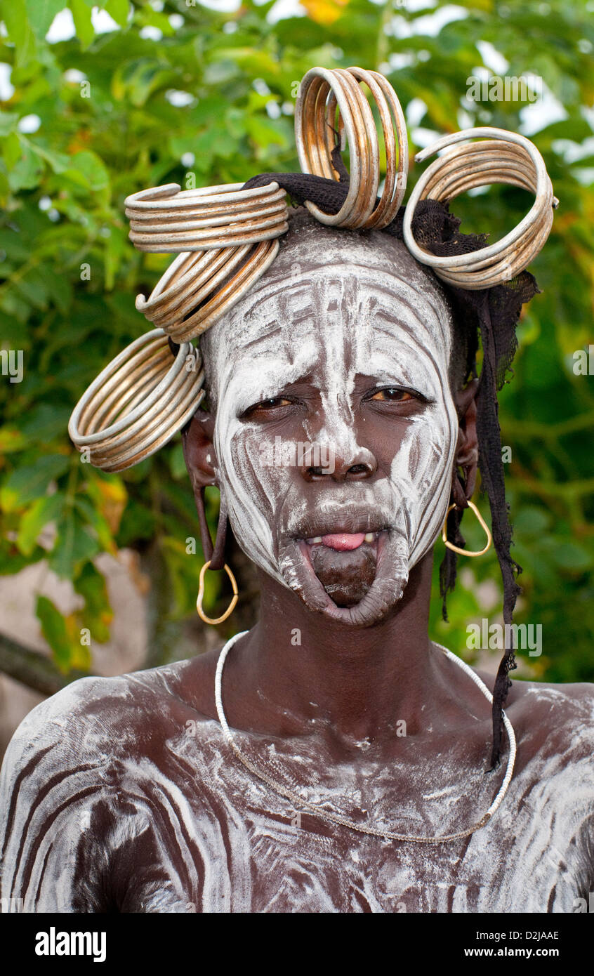 Head shot of painted and decorated Mursi woman-Omo Valley - Stock Image
