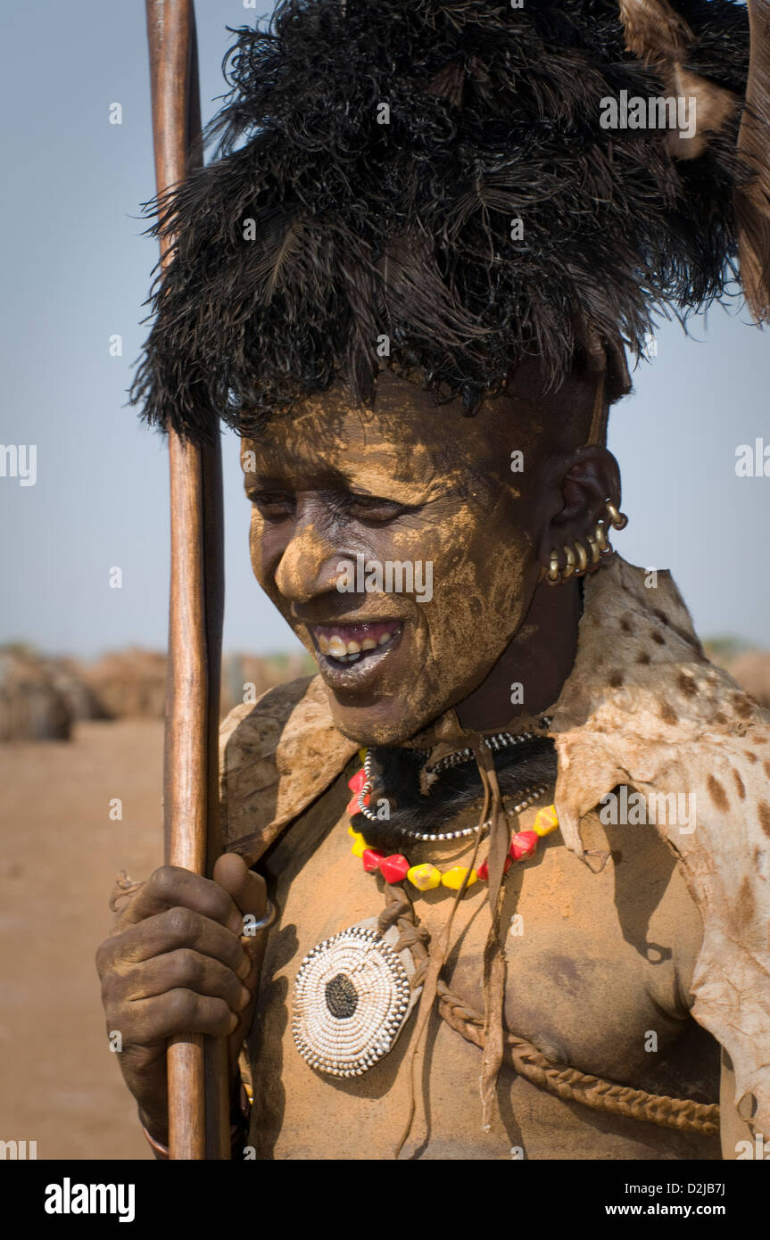 Head shot of Dassenech man dressed for Dimi ceremony with face and body painting. Wearing a feathered headdress - Stock Image