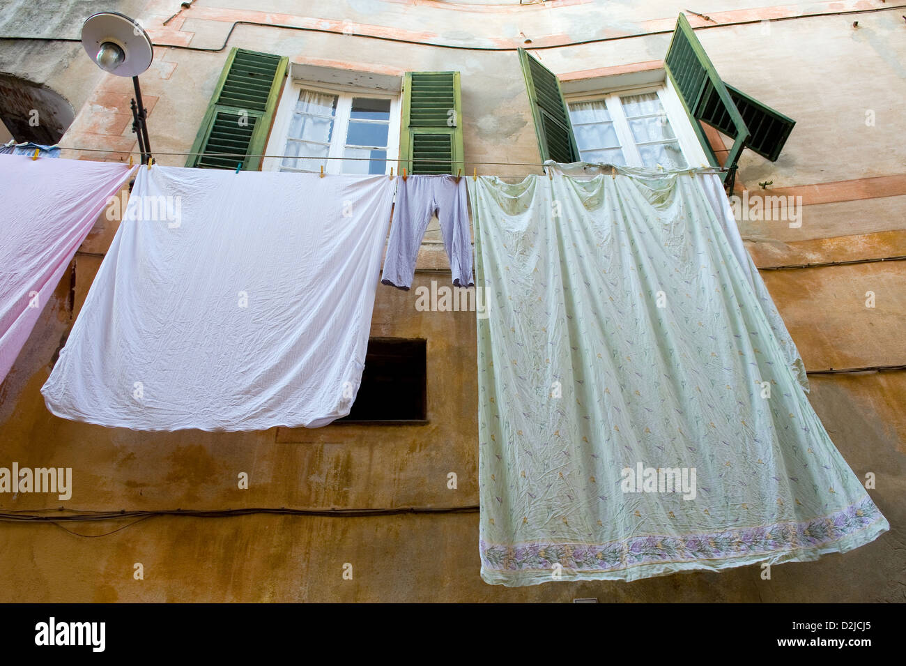 Finale Ligure, Italy, laundry hangs to dry out a window - Stock Image