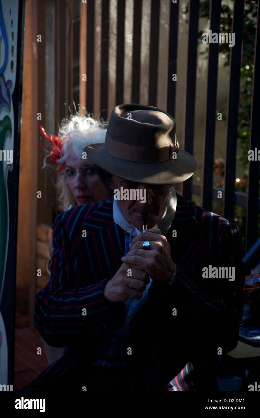 caught in the moment,man lighting a cigarett, - Stock Image