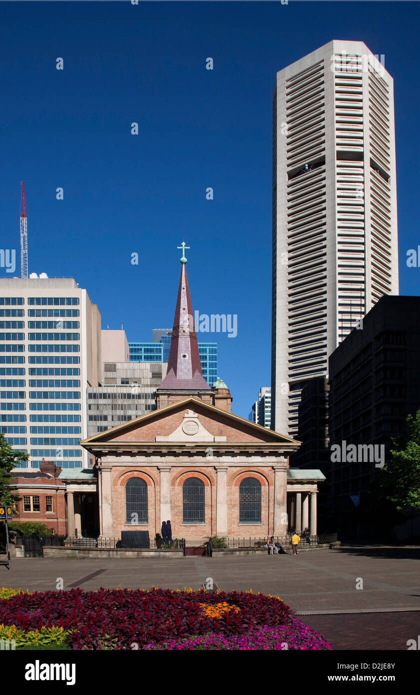 Sydney's oldest church St James  with MLC building in the background Macquarie Street Sydney Australia - Stock Image