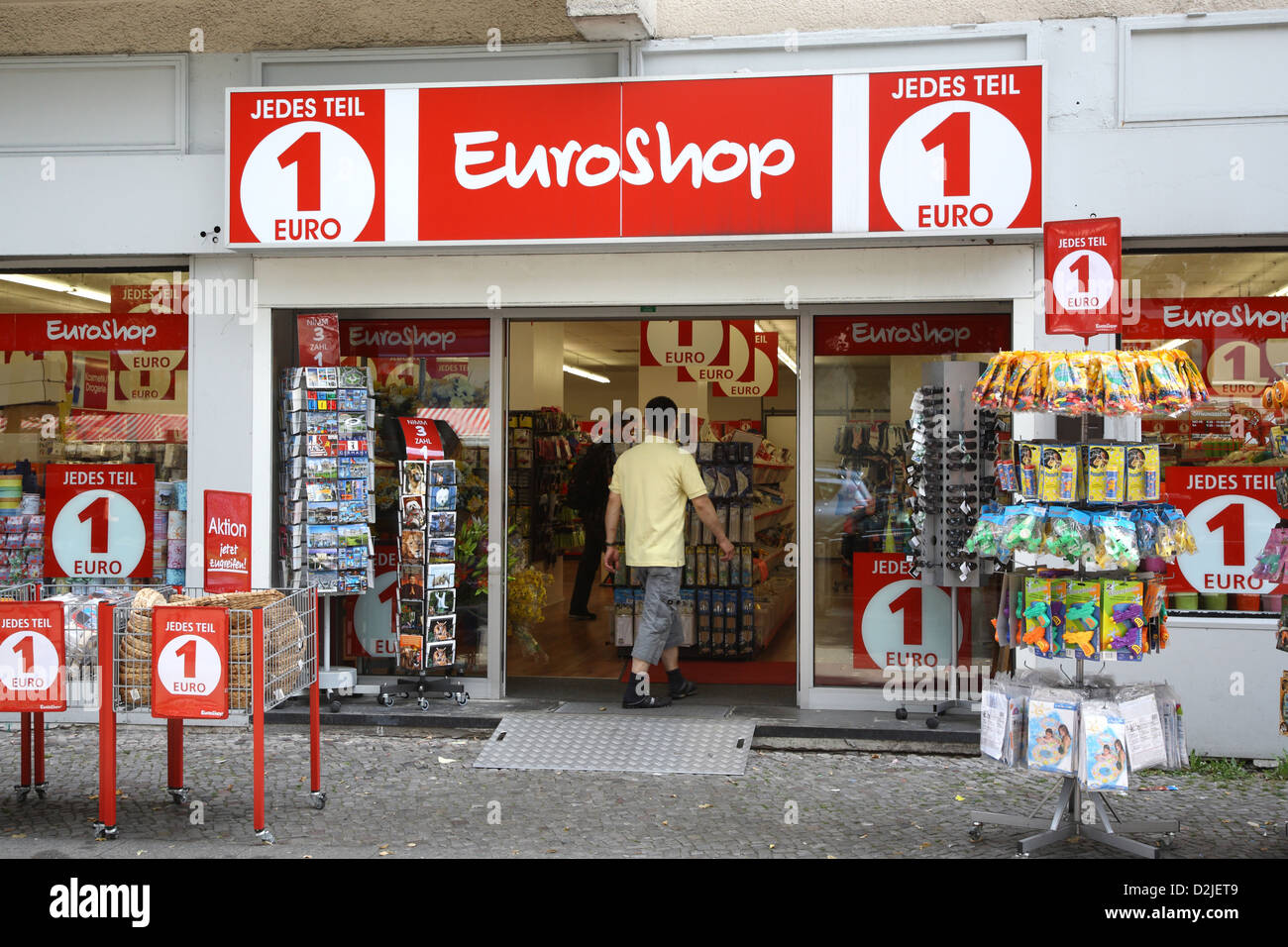 berlin germany a man walks into a euro shop stock photo 53267209 alamy