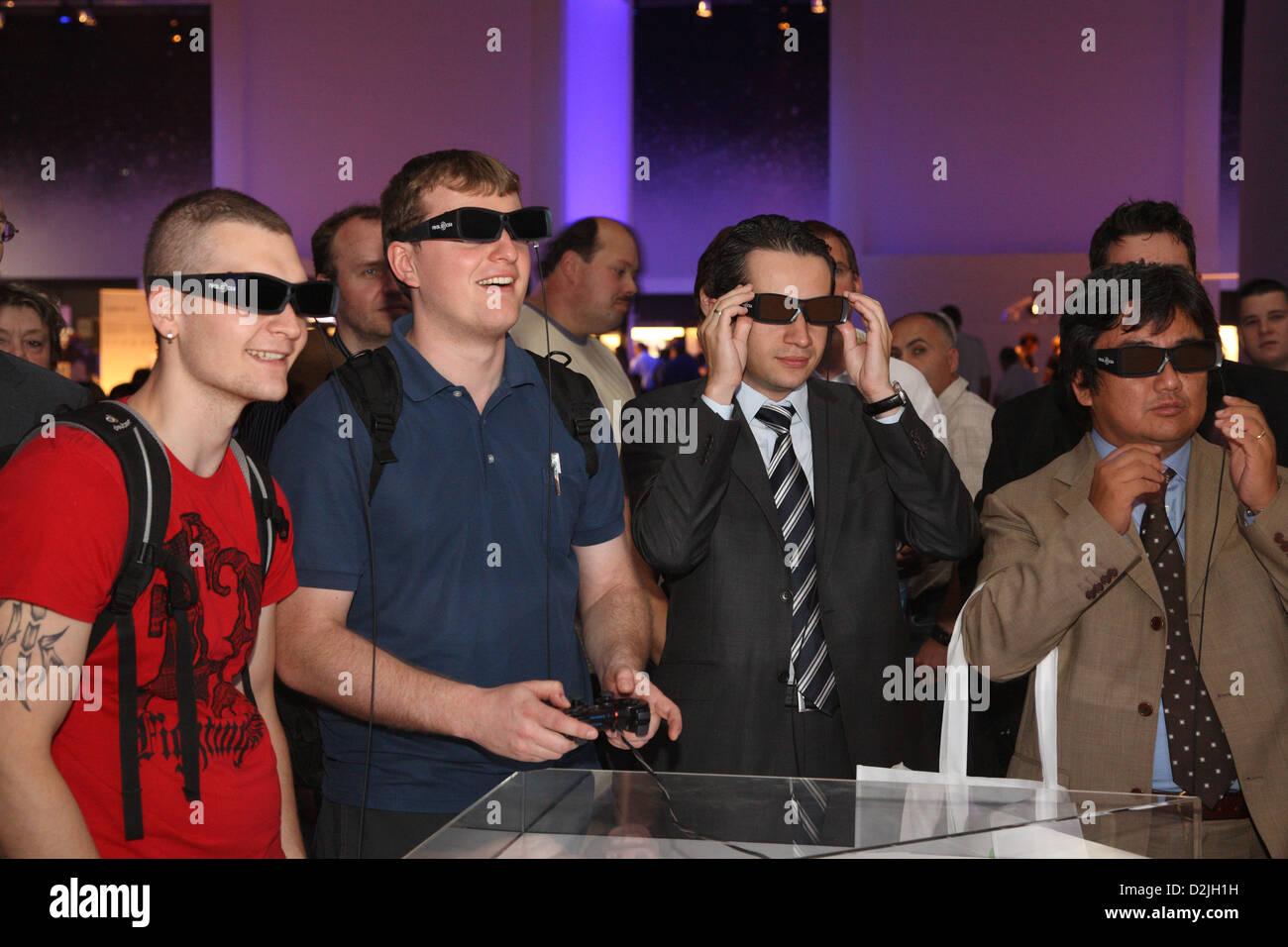 Berlin, Germany, visitors at IFA with 3D Eyewear play PlayStation 3 - Stock Image