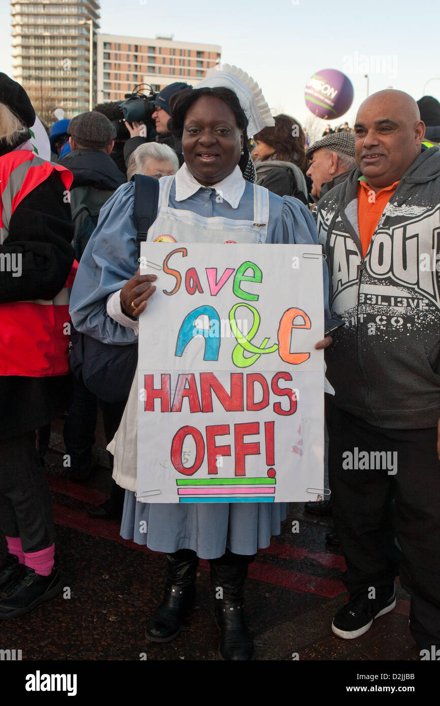 London UK. 26th January 2013. . Woman wearing nurses uniform holding placard reading A&E Hands off preparing - Stock Image