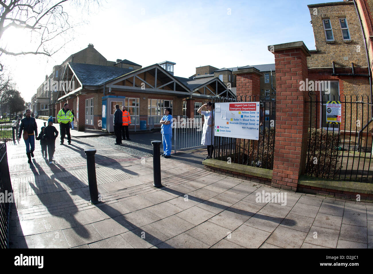 London UK. 26th January 2013. . Workers at Lewisham hospital step out to see the thousands of local people marching - Stock Image