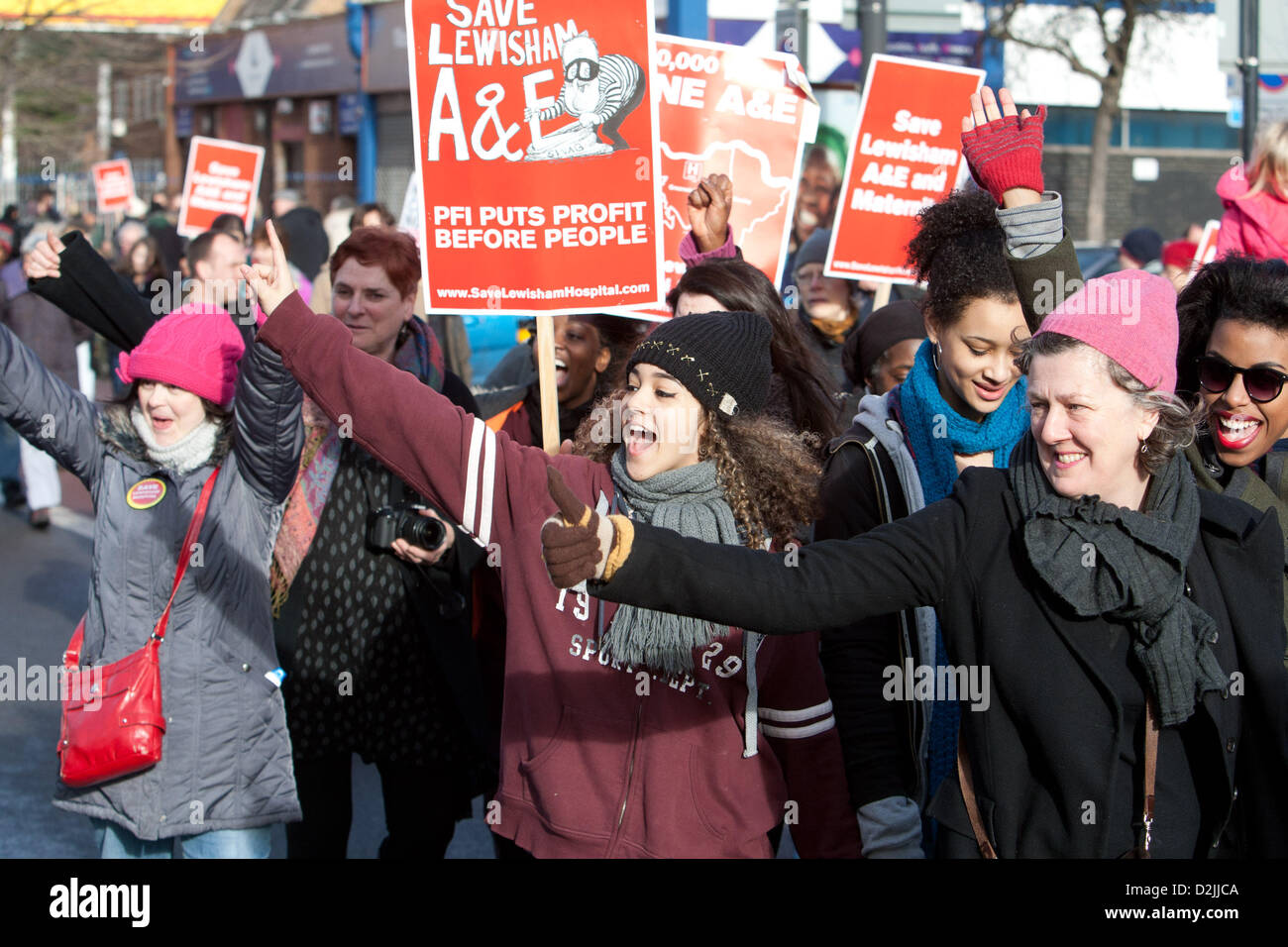 London UK. 26th January 2013. . Thumbs up to cars tooting support as thousands of local people march to a rally - Stock Image