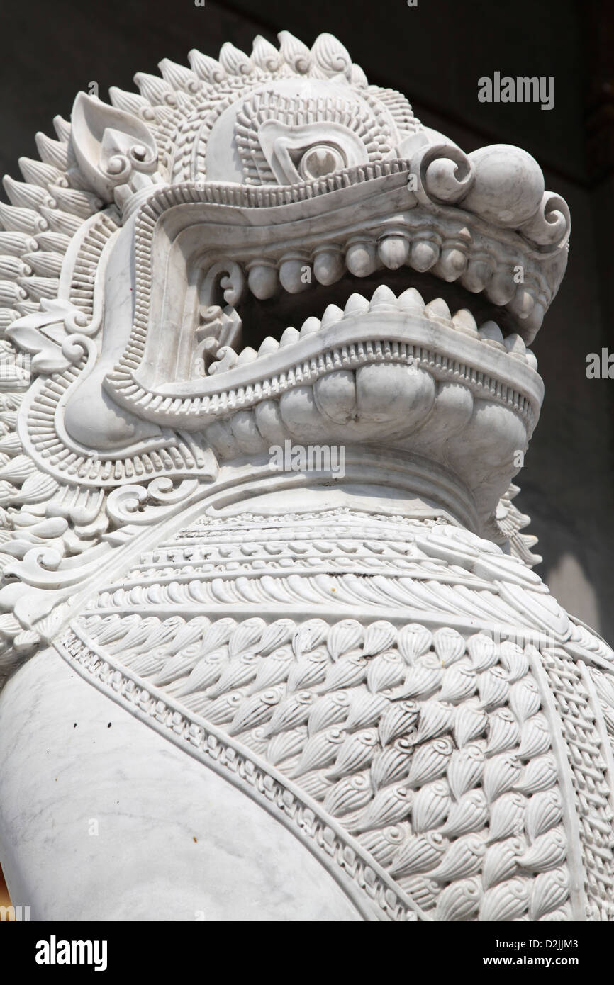This fierce marble Dragon guards a Thai Temple entrance - Stock Image
