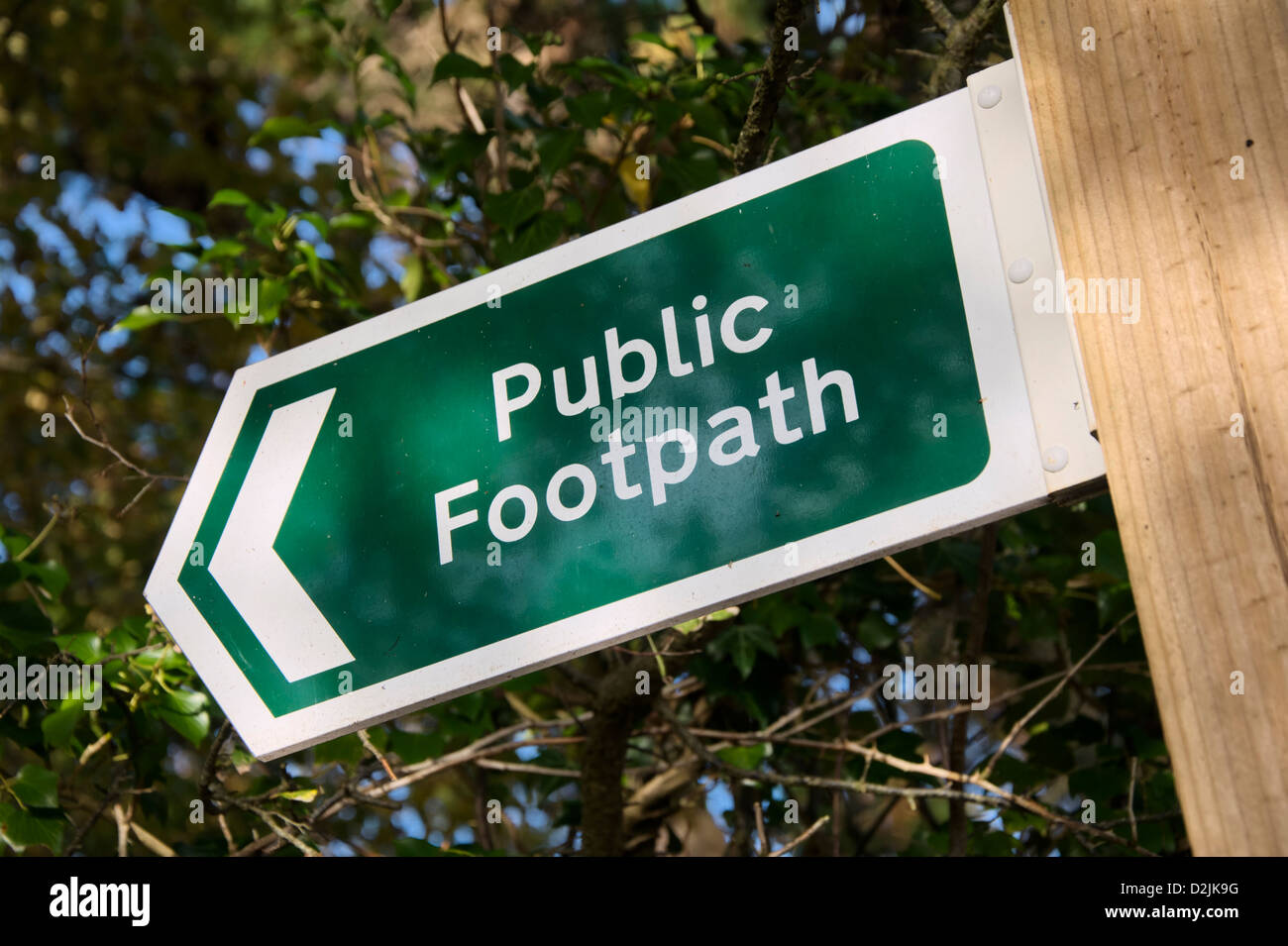 Signpost indicating a Public Footpath - Stock Image