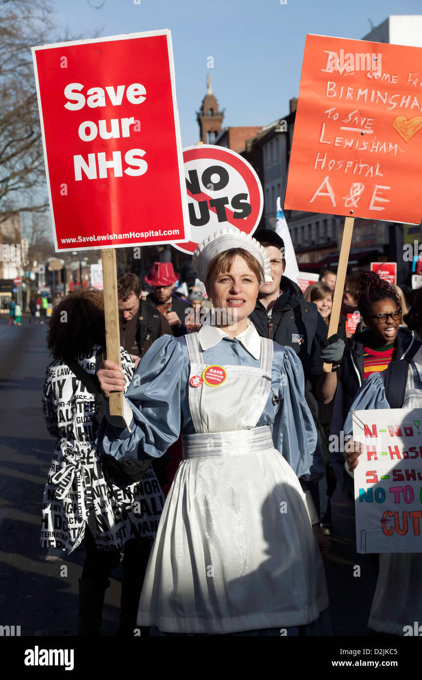 Demonstrators  marching  against Lewisham NHS cuts to the Maternity and A&E departments at Lewisham Hospital - Stock Image