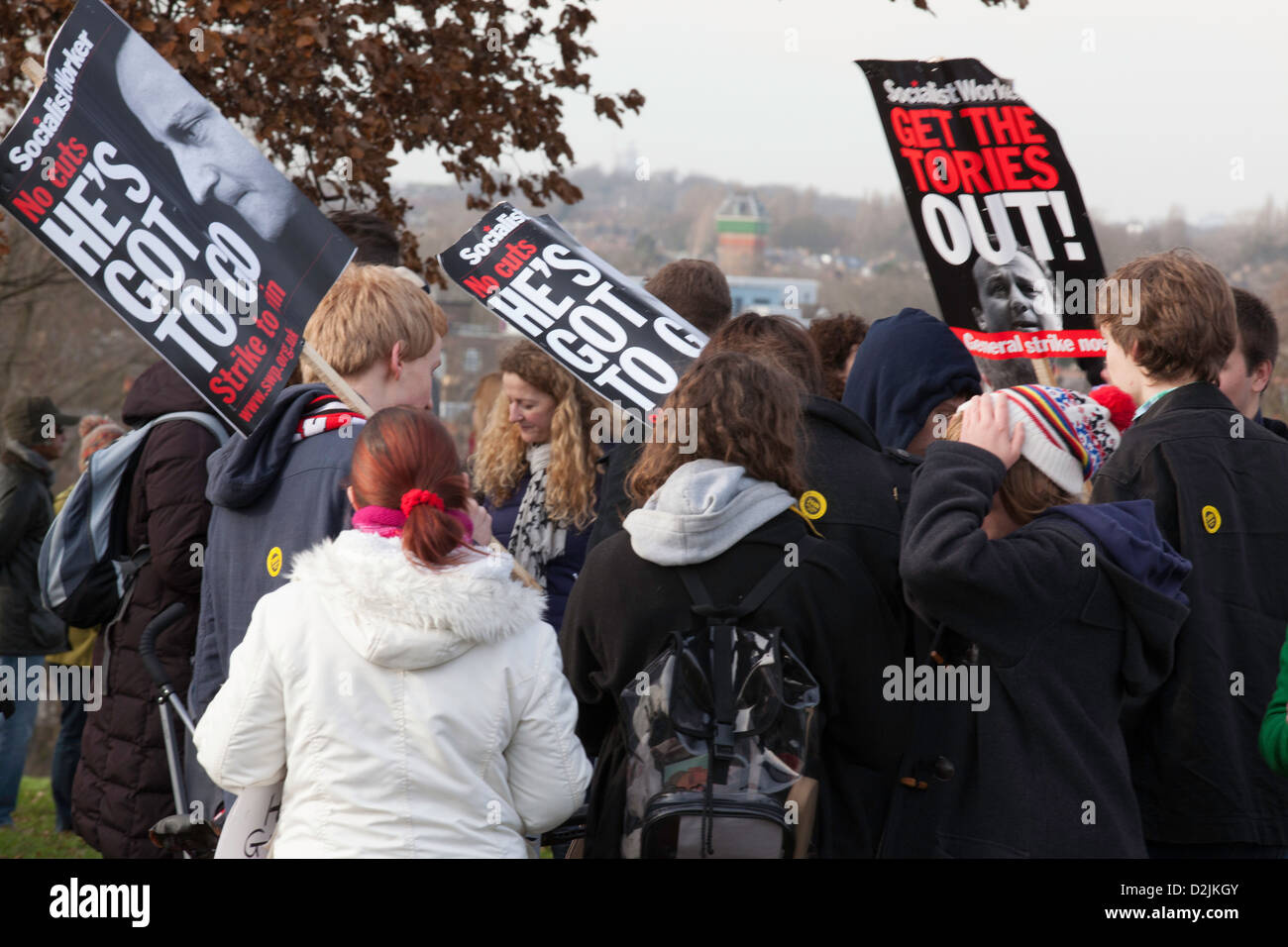 Protesters holding banners against the closure of Lewisham hospital and job cuts ,at the end of the march from Lewisham - Stock Image