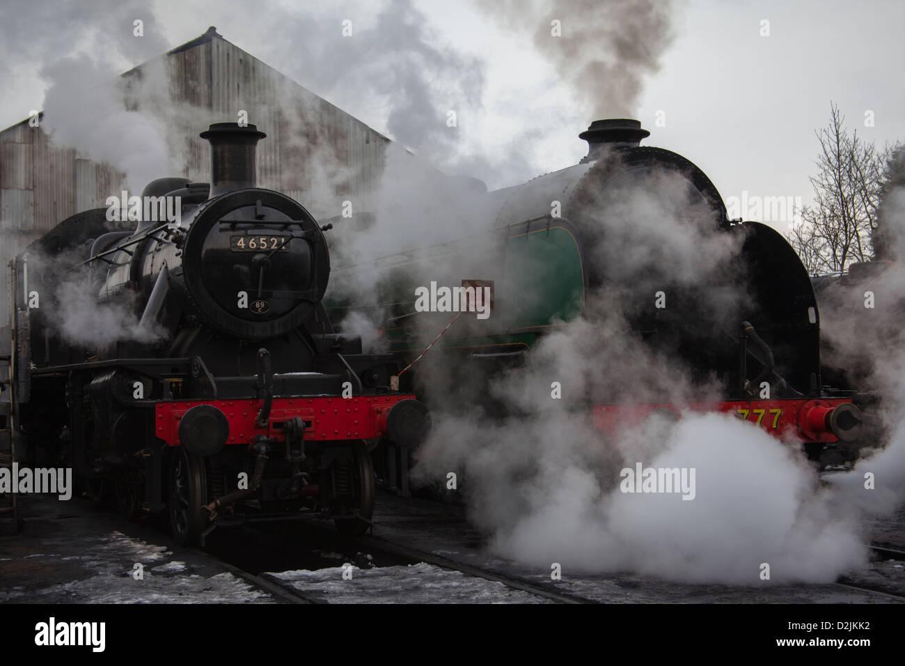 Steam locomotives Ivatt class number46521 and King Arthur class Sir Lamiel number 30777 - Stock Image