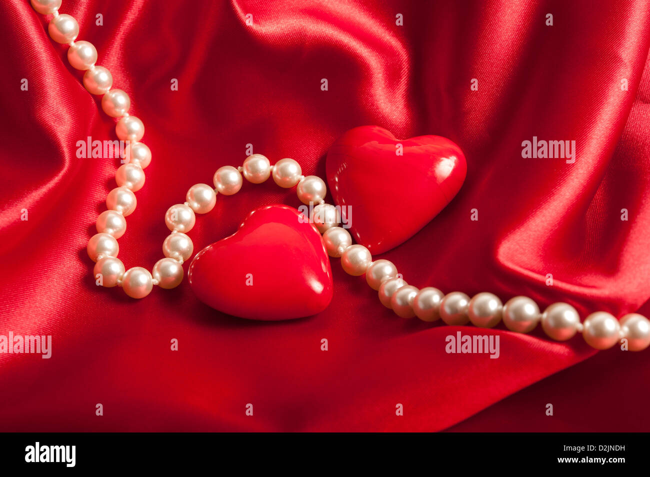 pearls necklace with two heart shapes, valentine concept - Stock Image