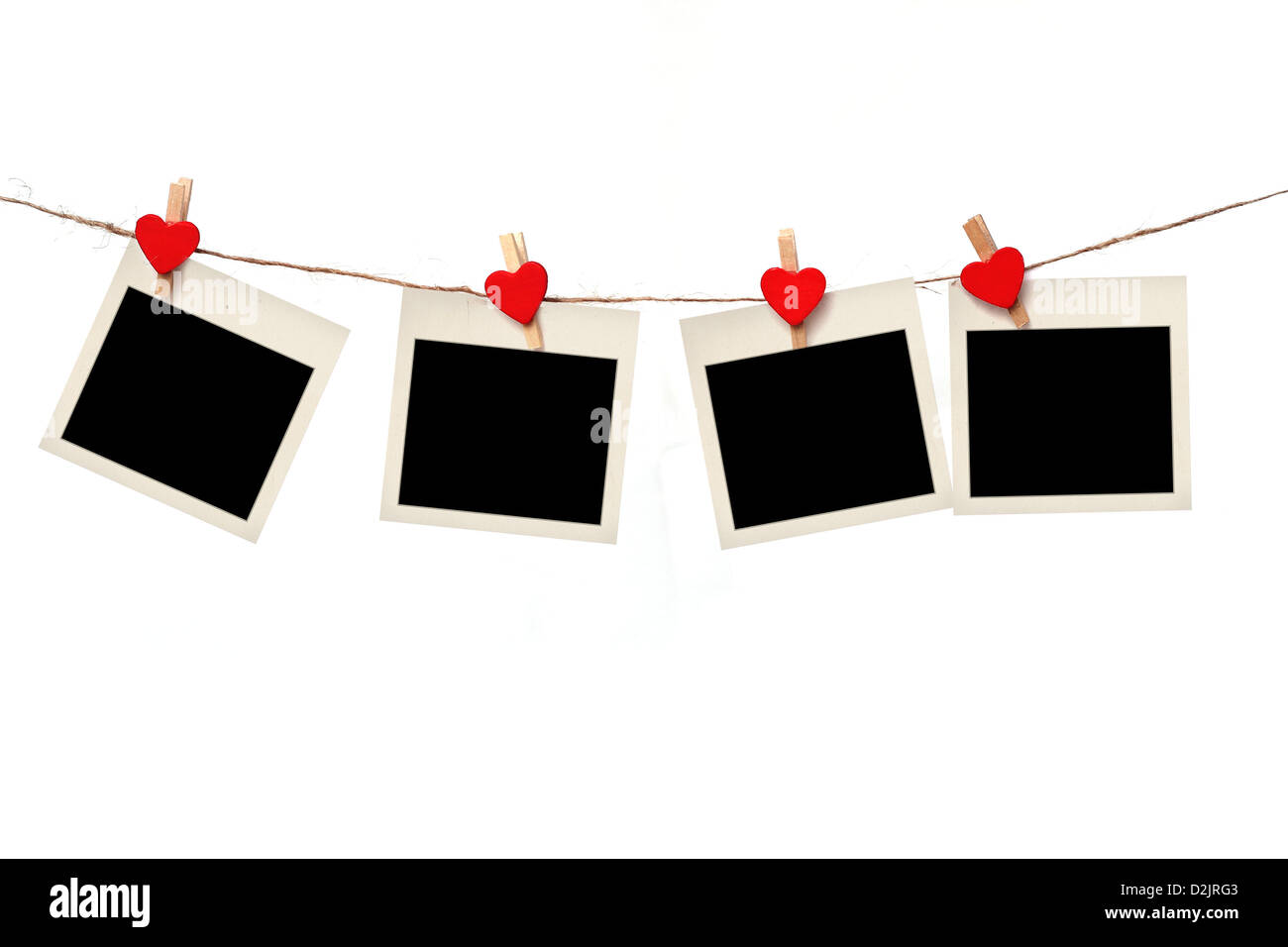 blank instant photos hanging on the clothesline. Isolated on white background. - Stock Image