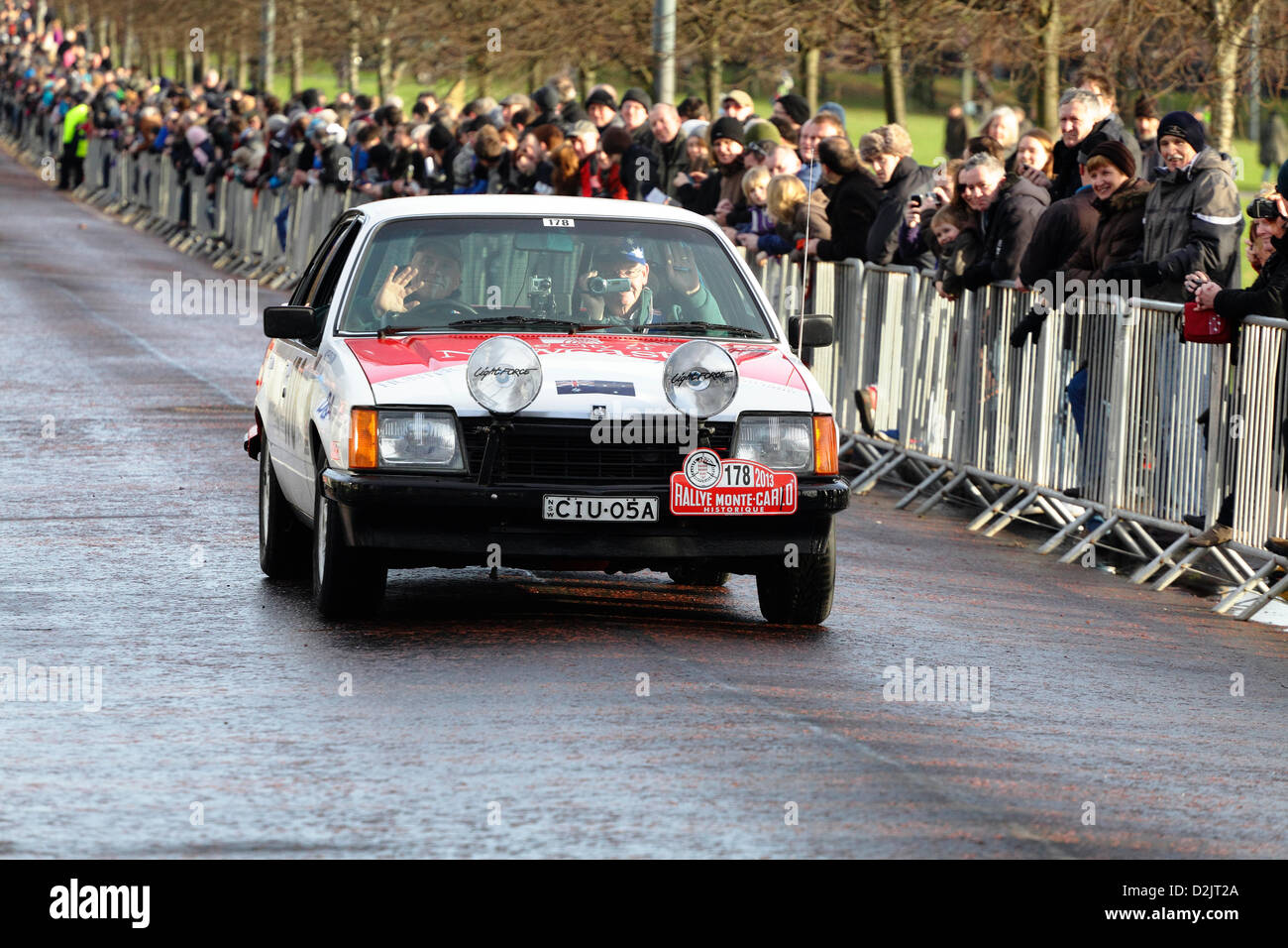 Spectators Watching A Holden Car Departing From Glasgow Green After The Start Of Monte Carlo