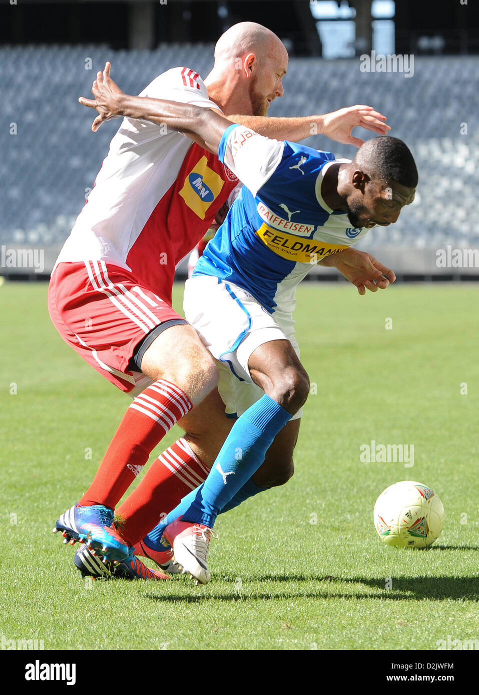 CAPE TOWN, South Africa - Saturday 26 January 2013, Matthew Booth of Ajax Cape Town and Anatole Ngamukol of Grasshopper - Stock Image
