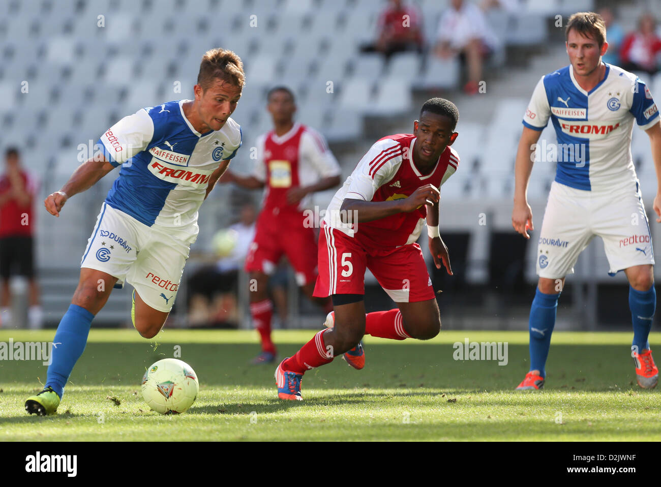 CAPE TOWN, South Africa - Saturday 26 January 2013, Amir Abrashi of Grasshopper Club Zurich and Mosa Lebusa of Ajax - Stock Image