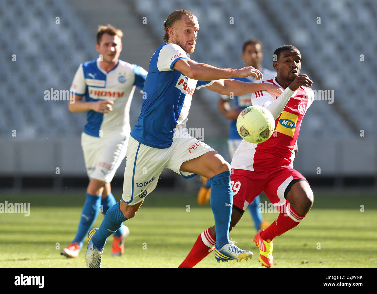 CAPE TOWN, South Africa - Saturday 26 January 2013, Michael Lang of Grasshopper Club Zurich and Abia Nale of Ajax - Stock Image