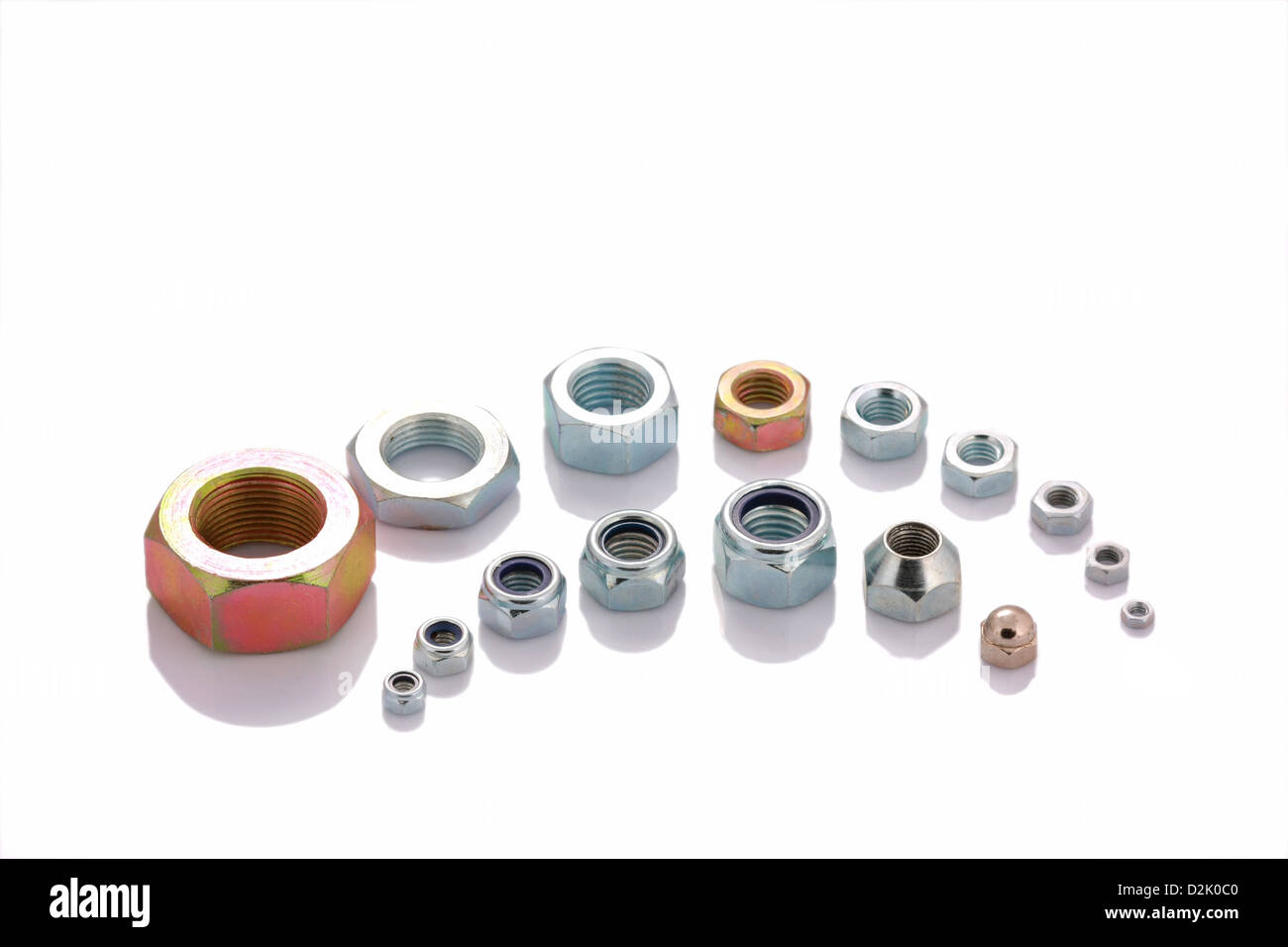 Varied steel nuts isolated on white background with copyspace - Stock Image