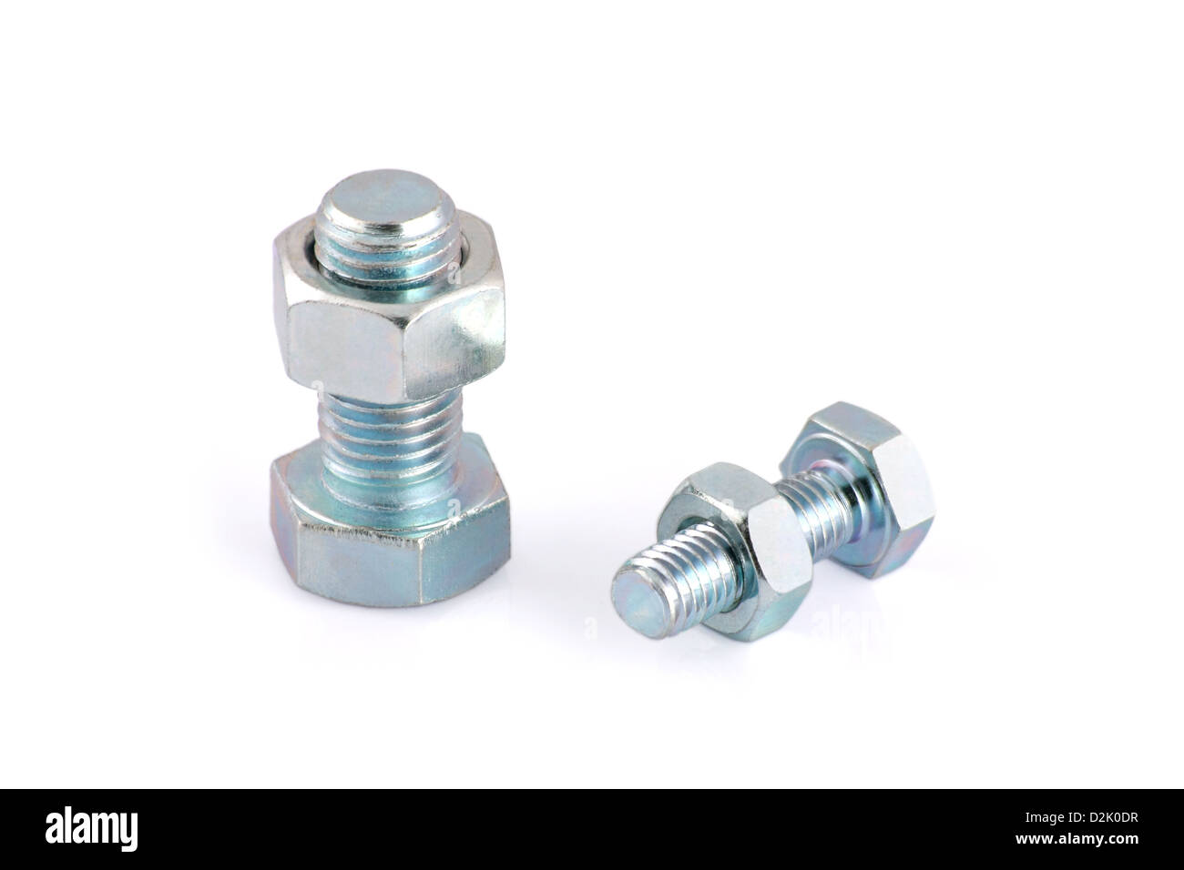 Two steel hexagon bolts and nuts isolated on white background - Stock Image