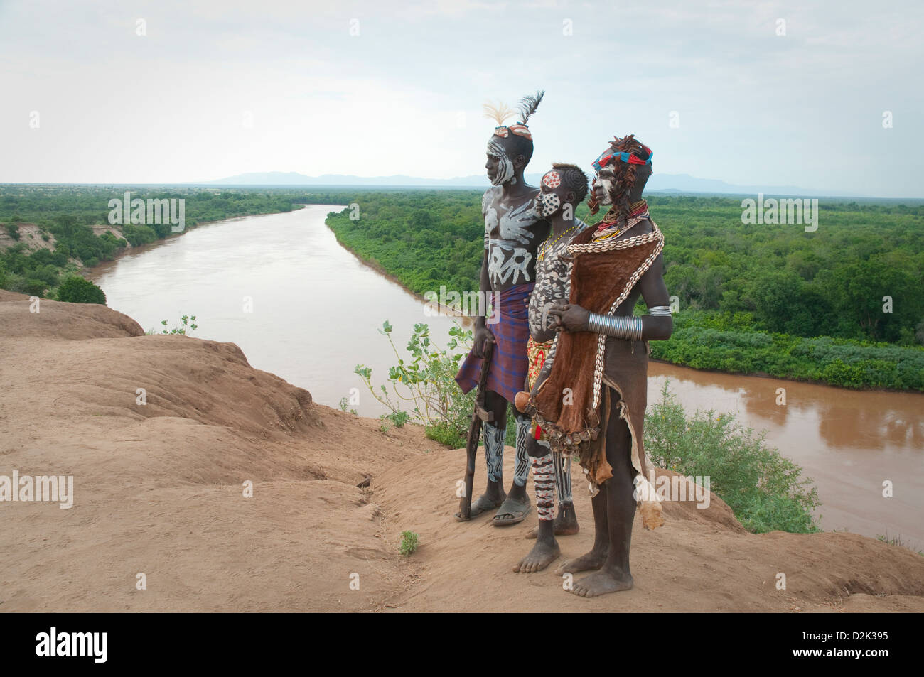 Portrait of painted and decorated Kara men and woman on bluff above Omo River - Stock Image