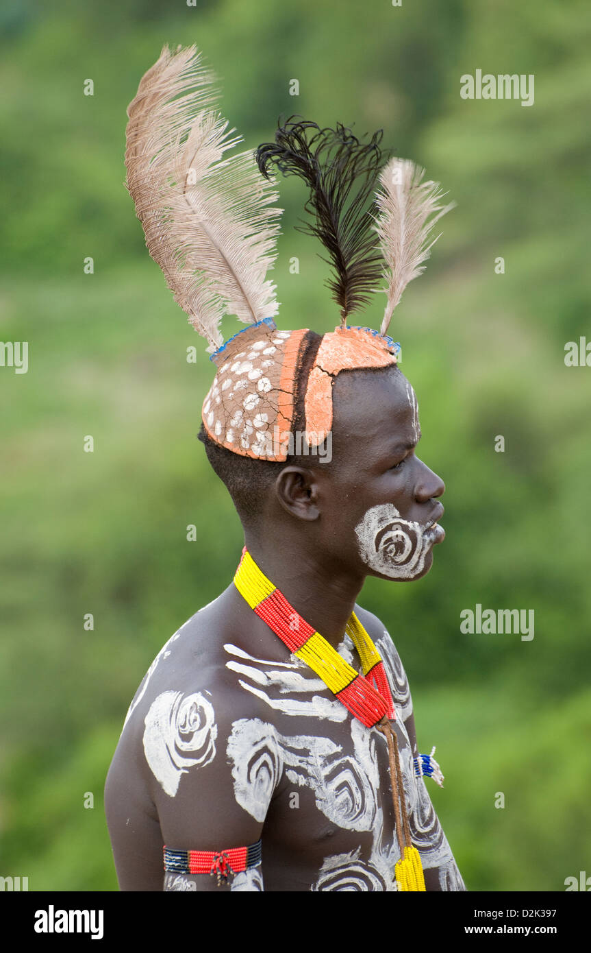 Portrait of Kara man with body painting and headdress - Stock Image