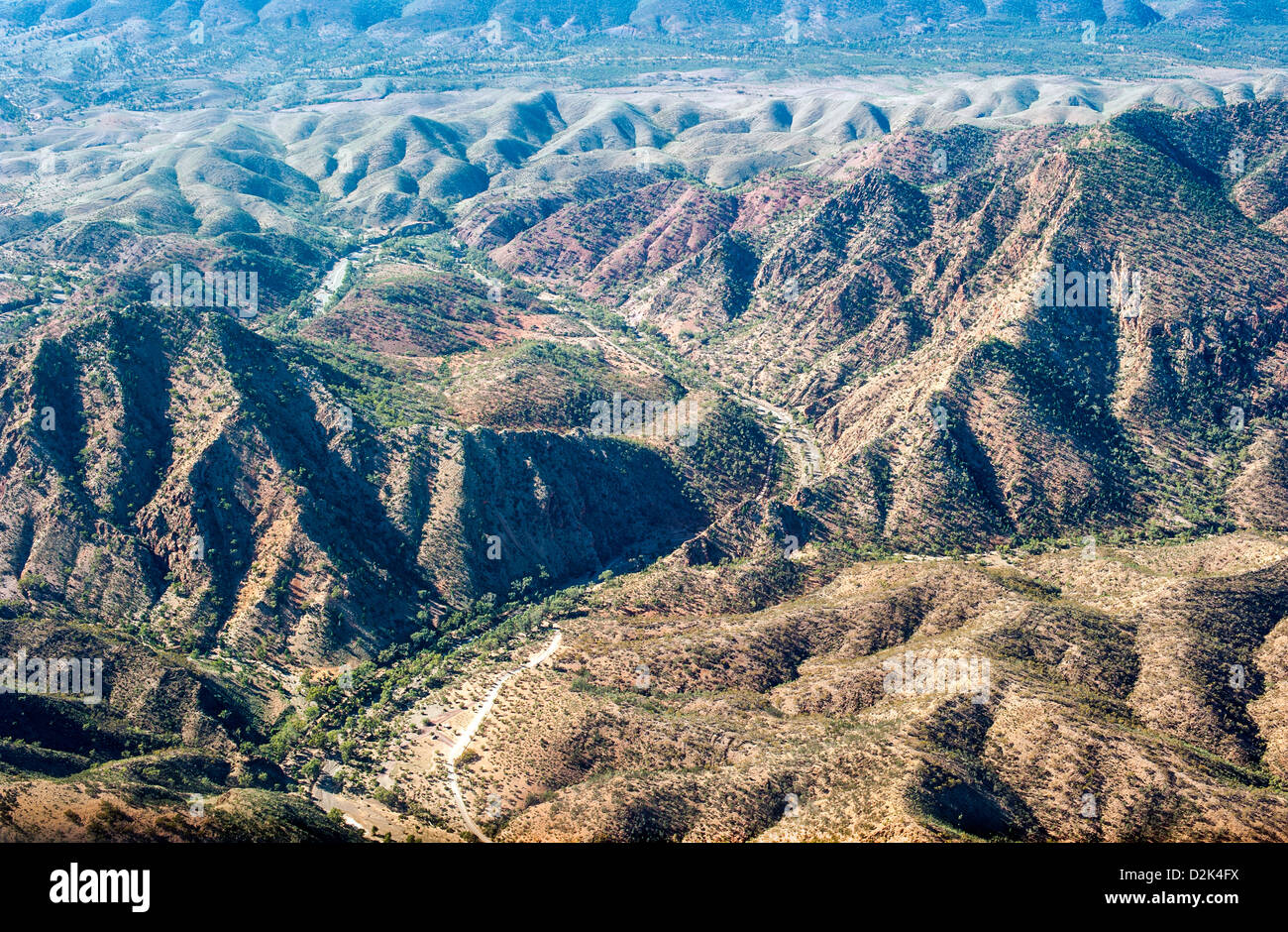 An aerial of almost bare rugged mountain terrain in South Australia's outback - Stock Image