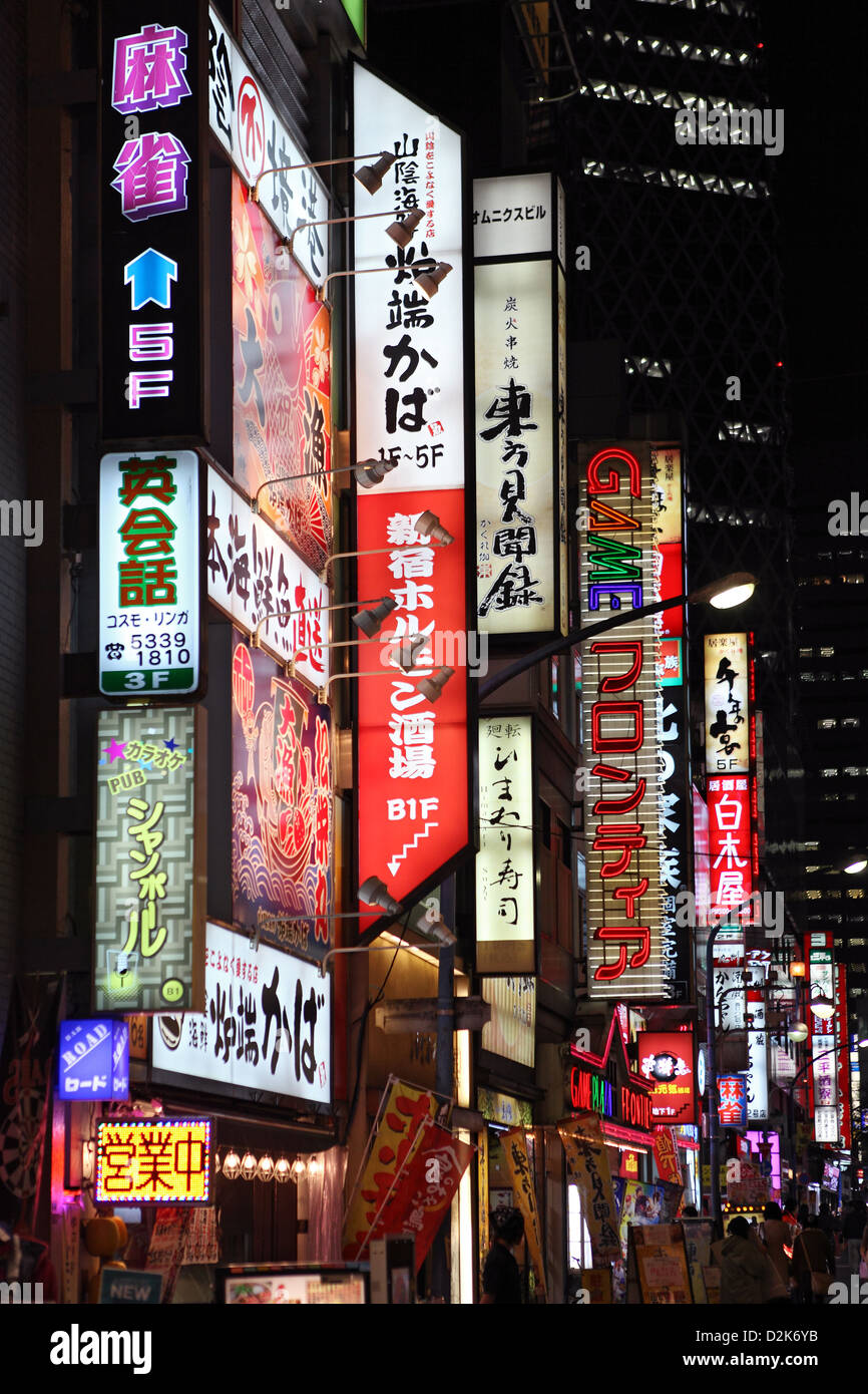 Tokyo, Japan, neon signs from a drainpipe - Stock Image