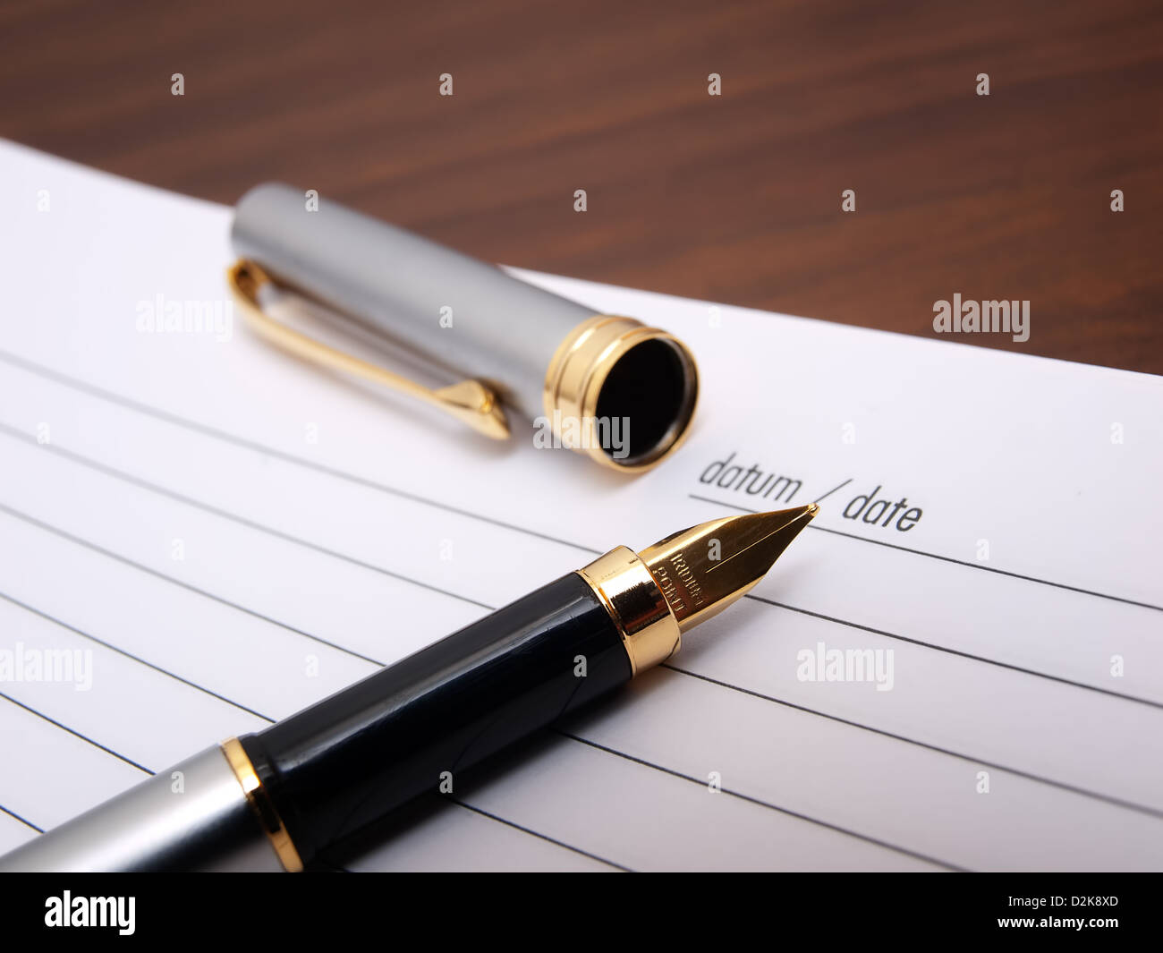 Closeup view of a fountain pen and diary book. - Stock Image