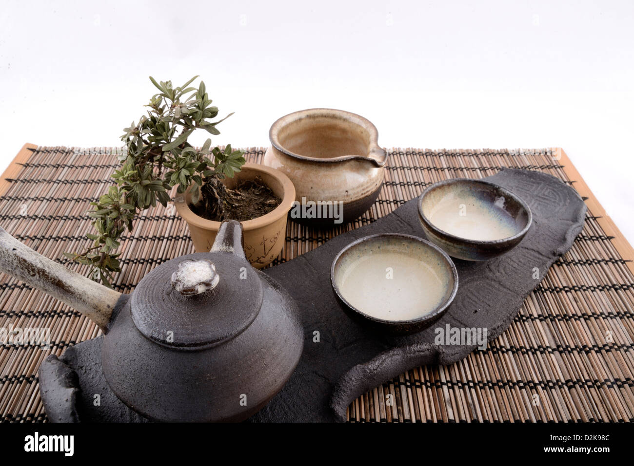 Product image of traditional Chinese tea set on a table setting with white seamless background. & Product image of traditional Chinese tea set on a table setting with ...