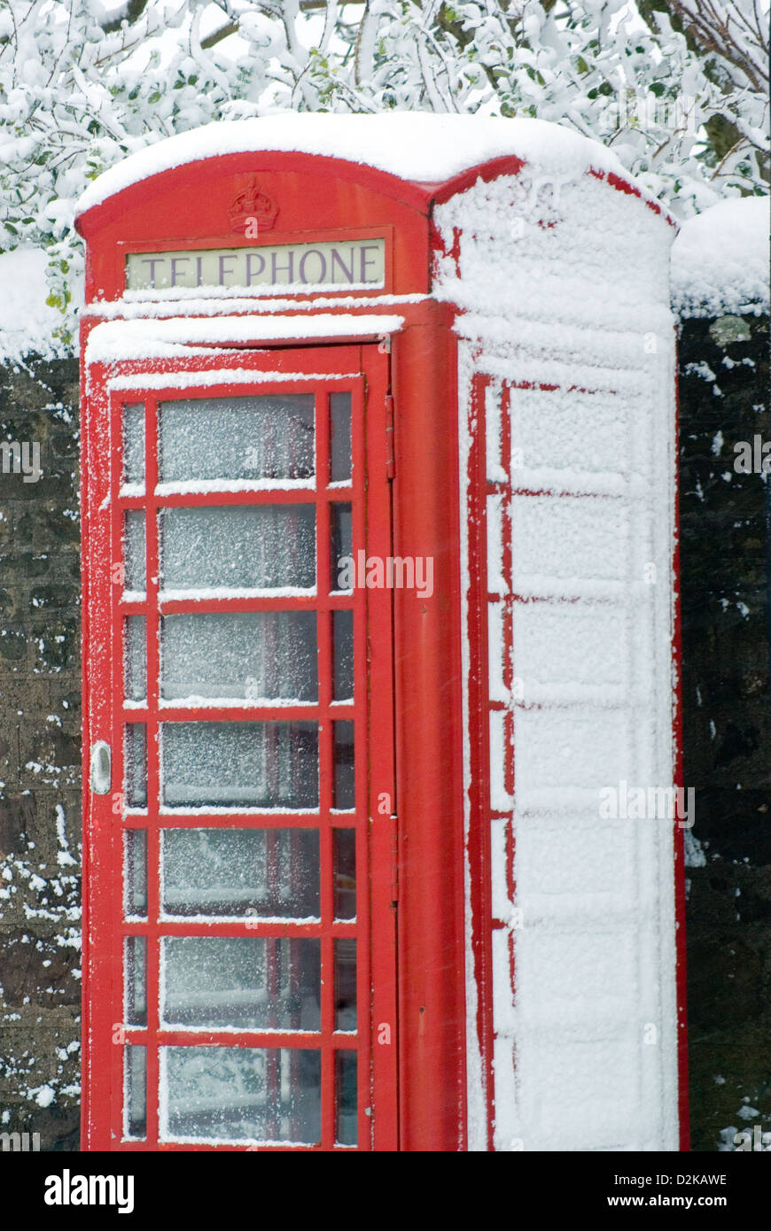 Uk , British, Red Telephone box with snow. - Stock Image