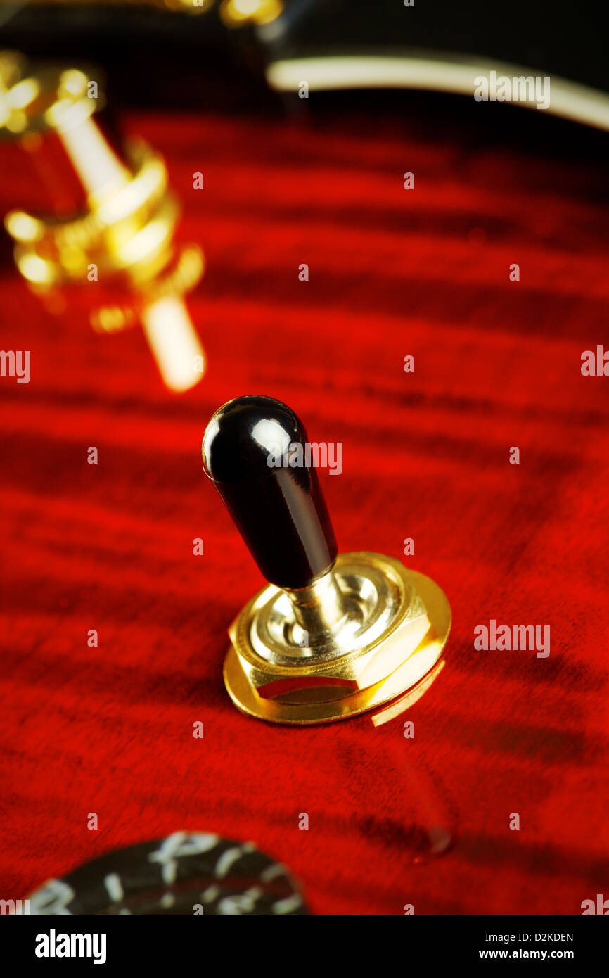 red electric guitar part, pickup toggle switch, closeup - Stock Image