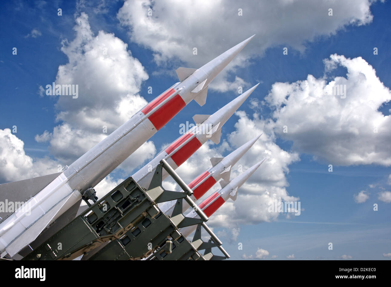 Four rockets of a surface-to-air missile system are aimed in the sky - Stock Image