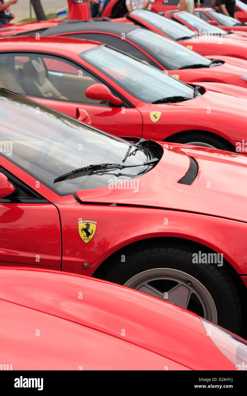 a line up of red Ferrari automobiles Stock Photo