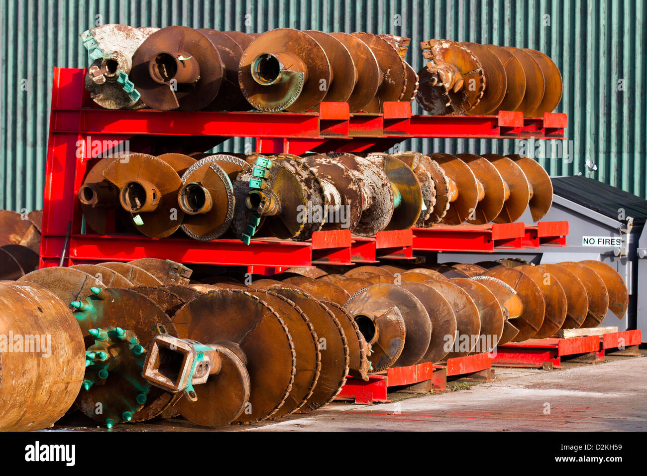 Rusty used augers on racks; Geotechnical drilling equipment Specialists _ Bachy Soletanche Ltd in Burscough, Lancashire, - Stock Image