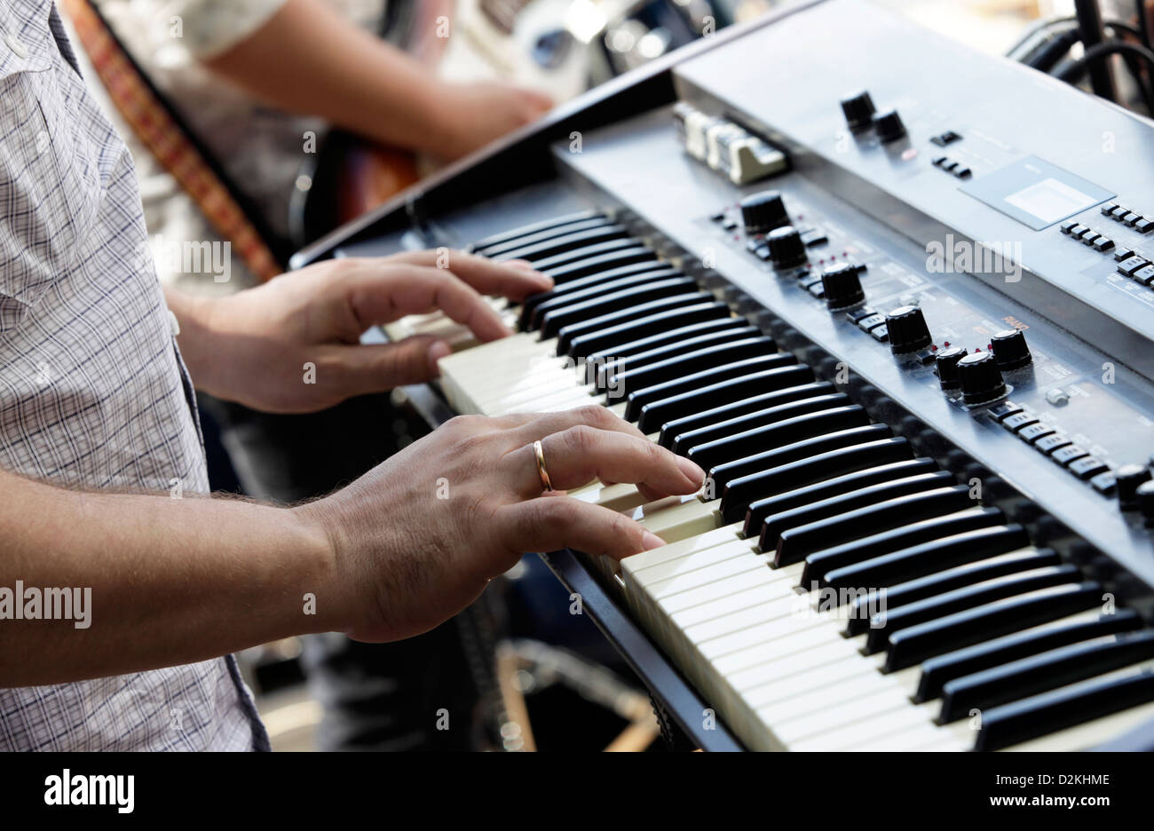 The man plays on an electric piano - Stock Image