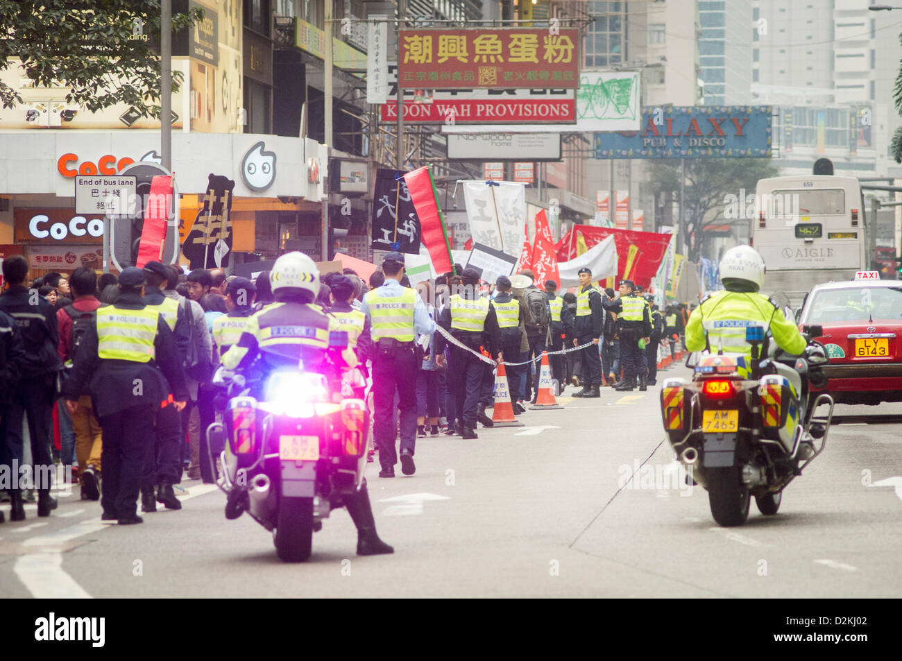 People gather for march to protest against the city leader on Sunday, 27 Jan 2013. Hong Kong, China. Stock Photo
