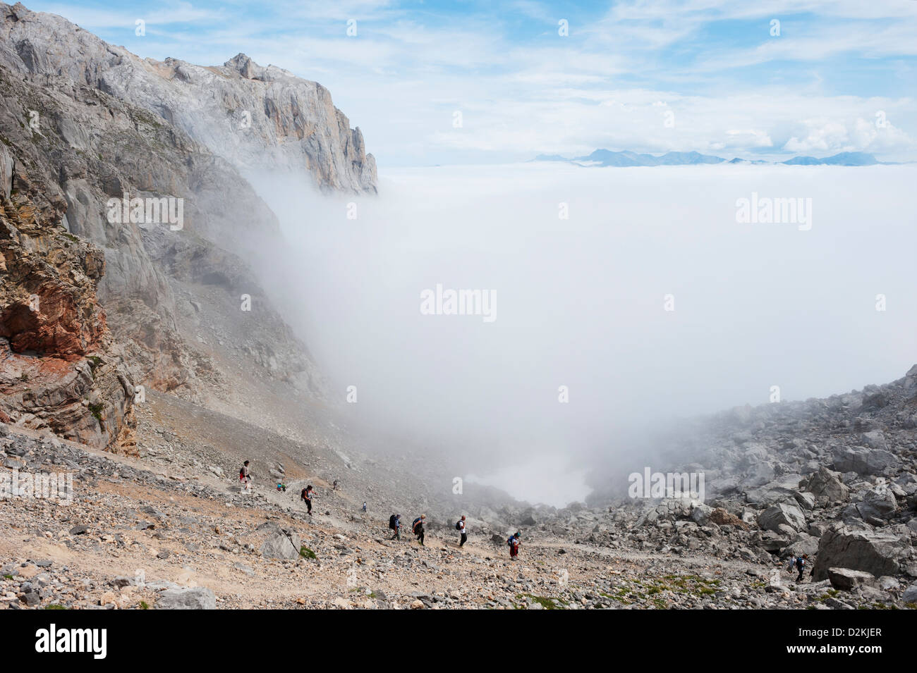 hikers, Picos de Europa National Park, shared by the provinces of Asturias, Cantabria and León, Spain - Stock Image