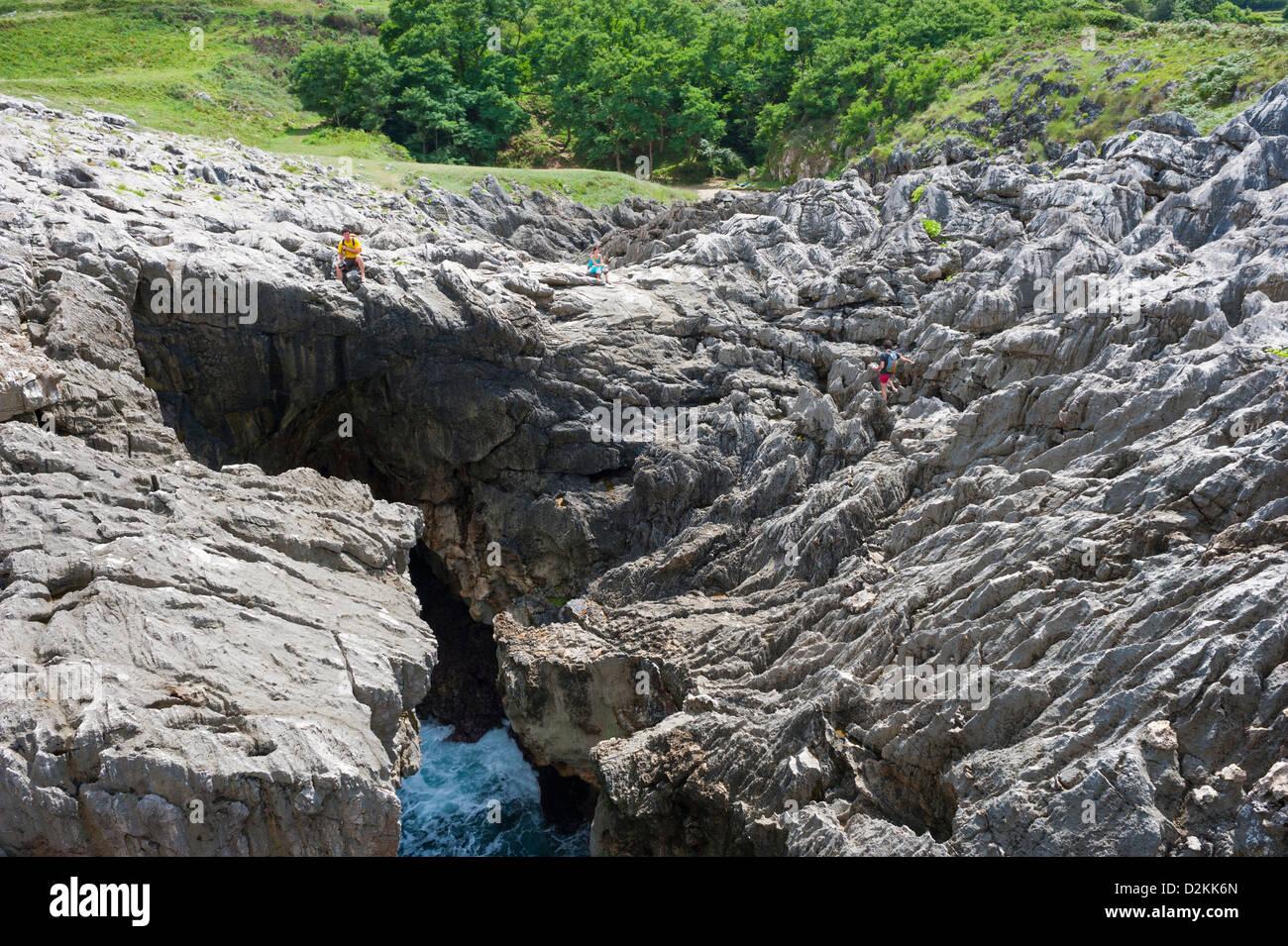 group of people on a coastal rock, provinces of Asturias, Spain - Stock Image