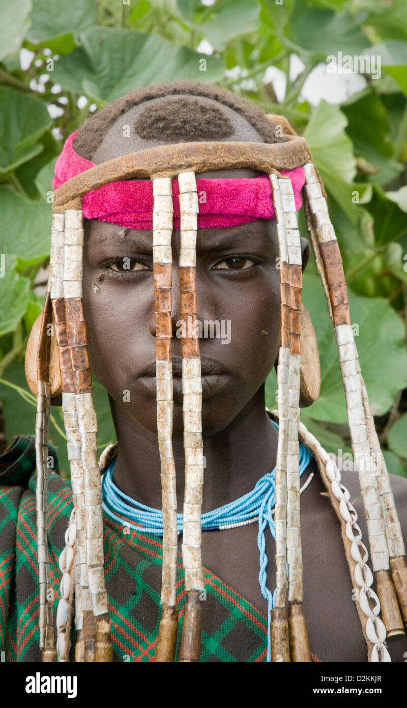 Portrait of Mursi woman with elaborate head ornament-Close up - Stock Image