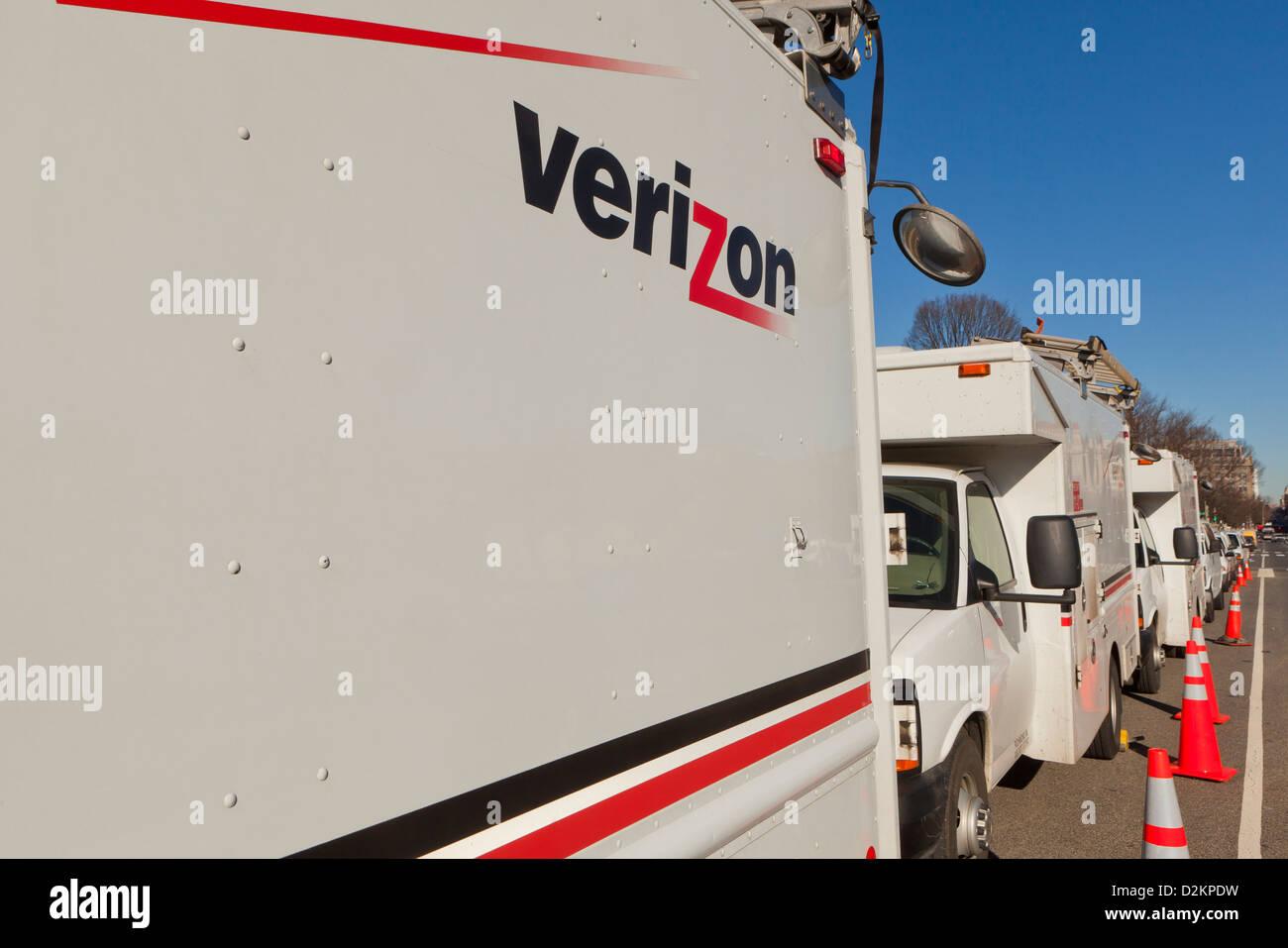 Verizon service trucks parked - Stock Image